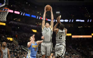 Feb 4, 2017; San Antonio, TX, USA; San Antonio Spurs forward David Lee (10) grabs a rebound against the Denver Nuggets during the second half at the AT&T Center. The Spurs won 121-97. Mandatory Credit: Brendan Maloney-USA TODAY Sports