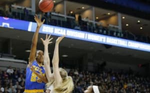 Mar 26, 2016; Bridgeport, CT, USA; UCLA Bruins forward Monique Billings (25) shoots against Texas Longhorns forward Sara Hattis (33) during the first half in the semifinals of the Bridgeport regional of the women