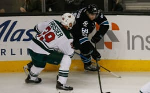 Jan 5, 2017; San Jose, CA, USA; San Jose Sharks center Melker Karlsson (68) and Minnesota Wild defenseman Nate Prosser (39) fight for control of the puck during the second period of the game at SAP Center at San Jose. The Minnesota Wild defeated the San Jose Sharks with a score of 5-4. Mandatory Credit: Stan Szeto-USA TODAY Sports