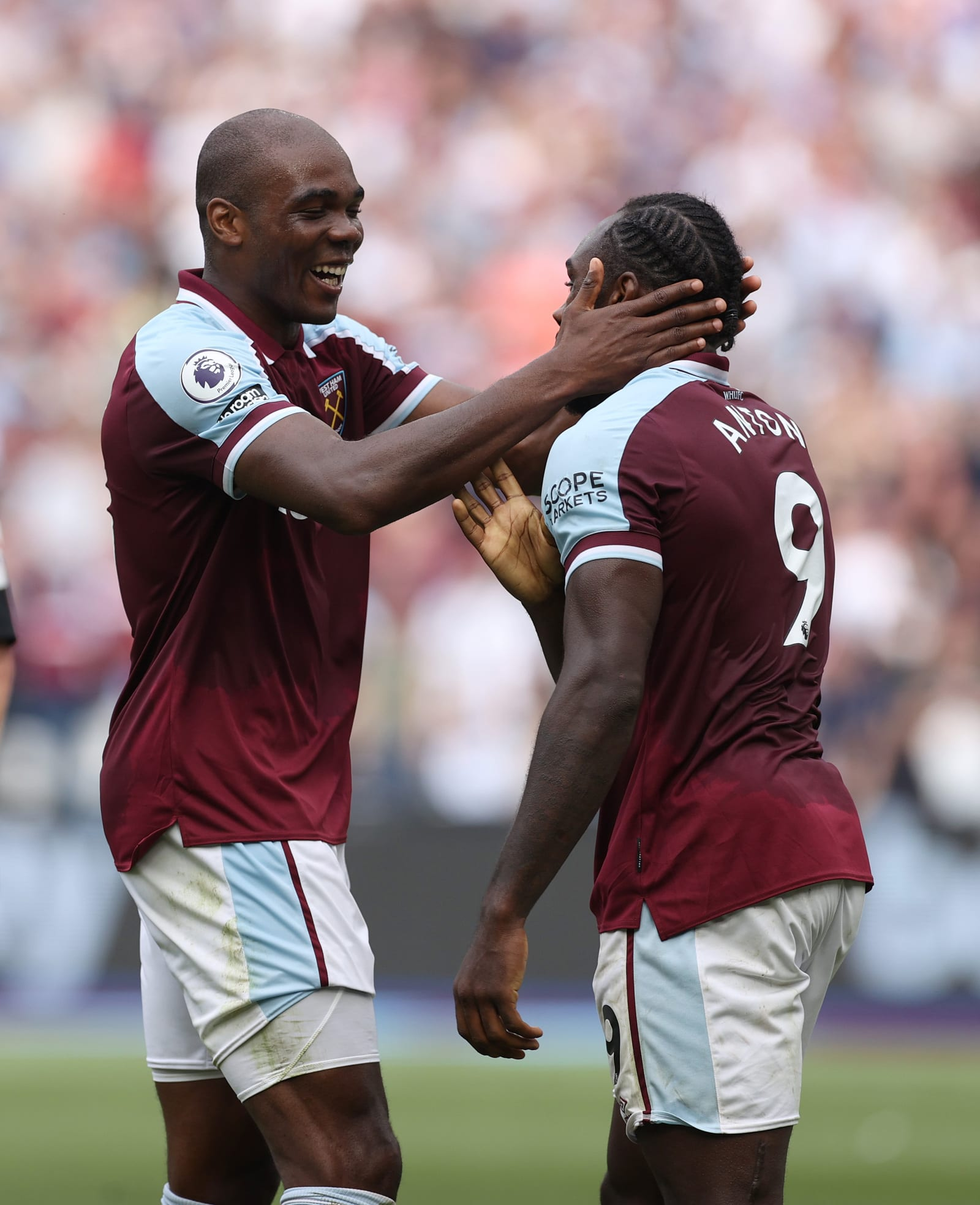 Michail Antonio of West Ham United is congratulated on his first goal by Angelo Ogbonna. (Photo by Eddie Keogh/Getty Images)