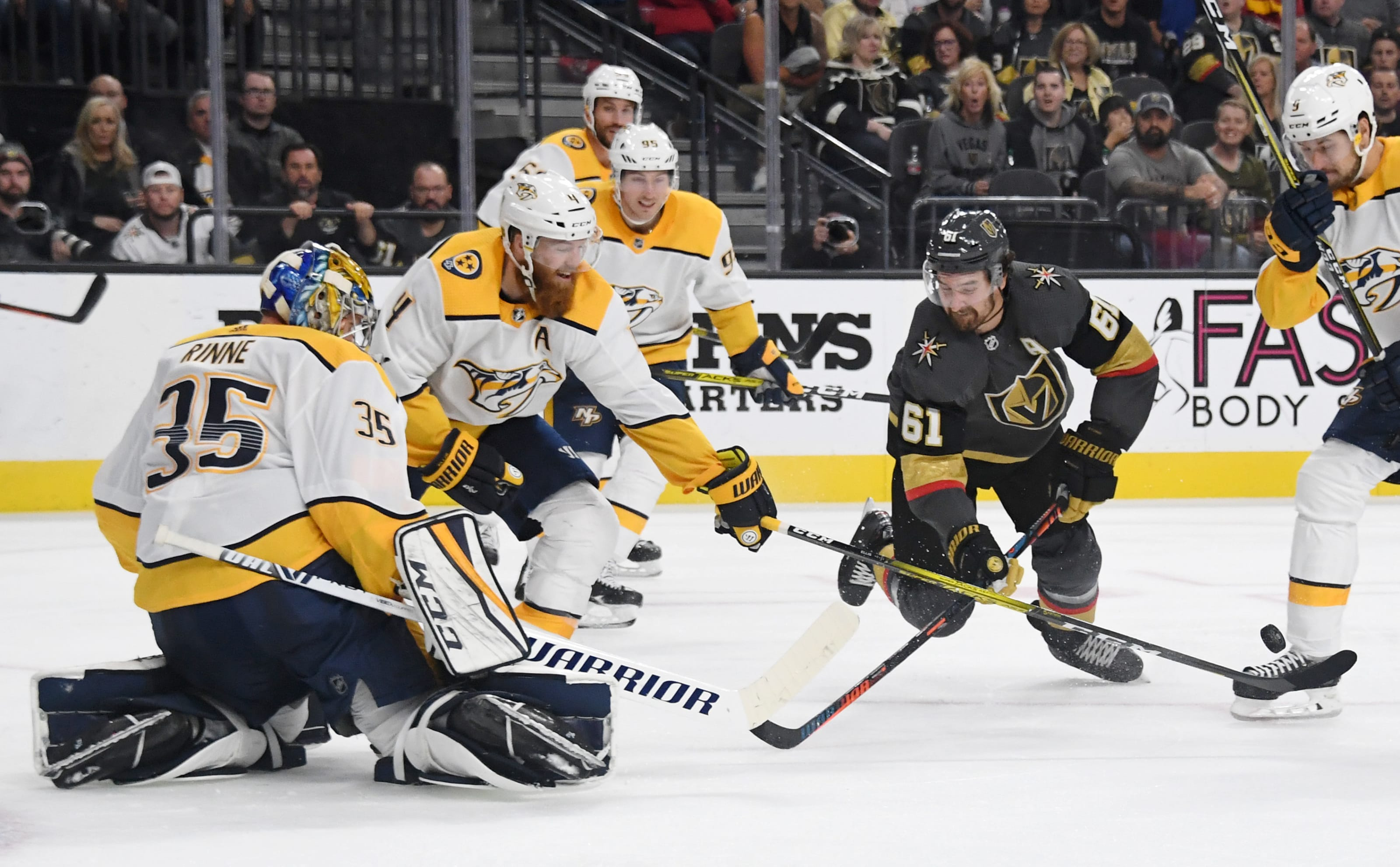 Ryan Ellis #4 of the Nashville Predators knocks the puck away from Mark Stone #61 of the Vegas Golden Knights.