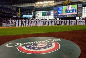 Apr 1, 2013; Milwaukee, WI, USA; Milwaukee Brewers and Colorado Rockies players line up for Opening Day game at Miller Park. Mandatory Credit: Benny Sieu-USA Today Sports