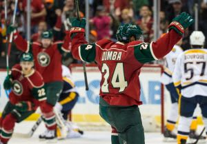 Nov 5, 2015; Saint Paul, MN, USA; Minnesota Wild defenseman Matt Dumba (24) celebrates his goal during the third period against the Nashville Predators at Xcel Energy Center. The Predators defeated the Wild 3-2. Mandatory Credit: Brace Hemmelgarn-USA TODAY Sports