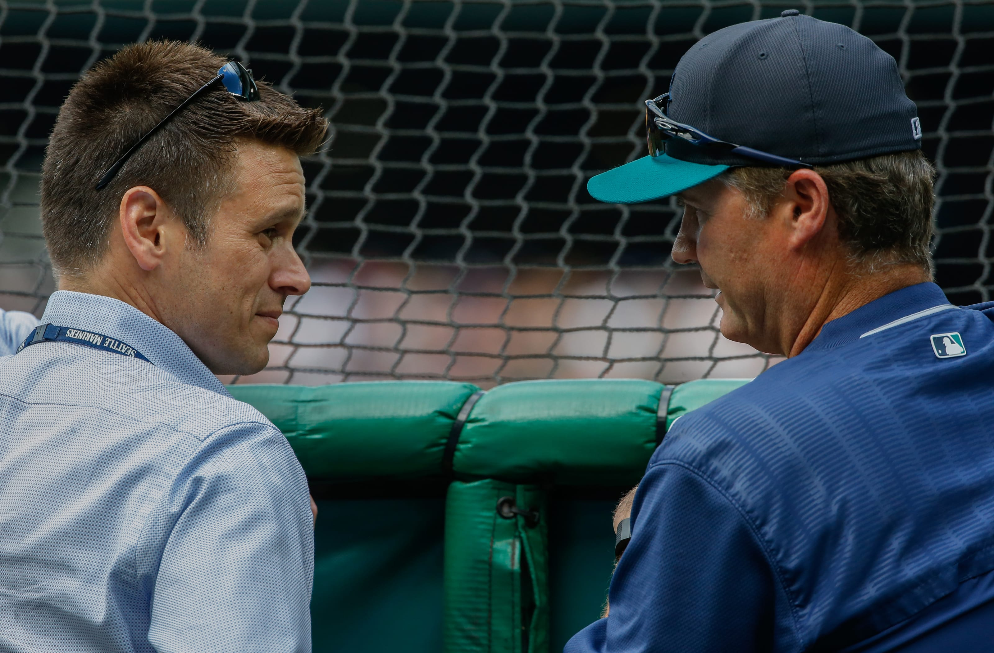 Jerry Dipoto and Scott Servais of the Seattle Mariners have a conversation during pre-game BP.