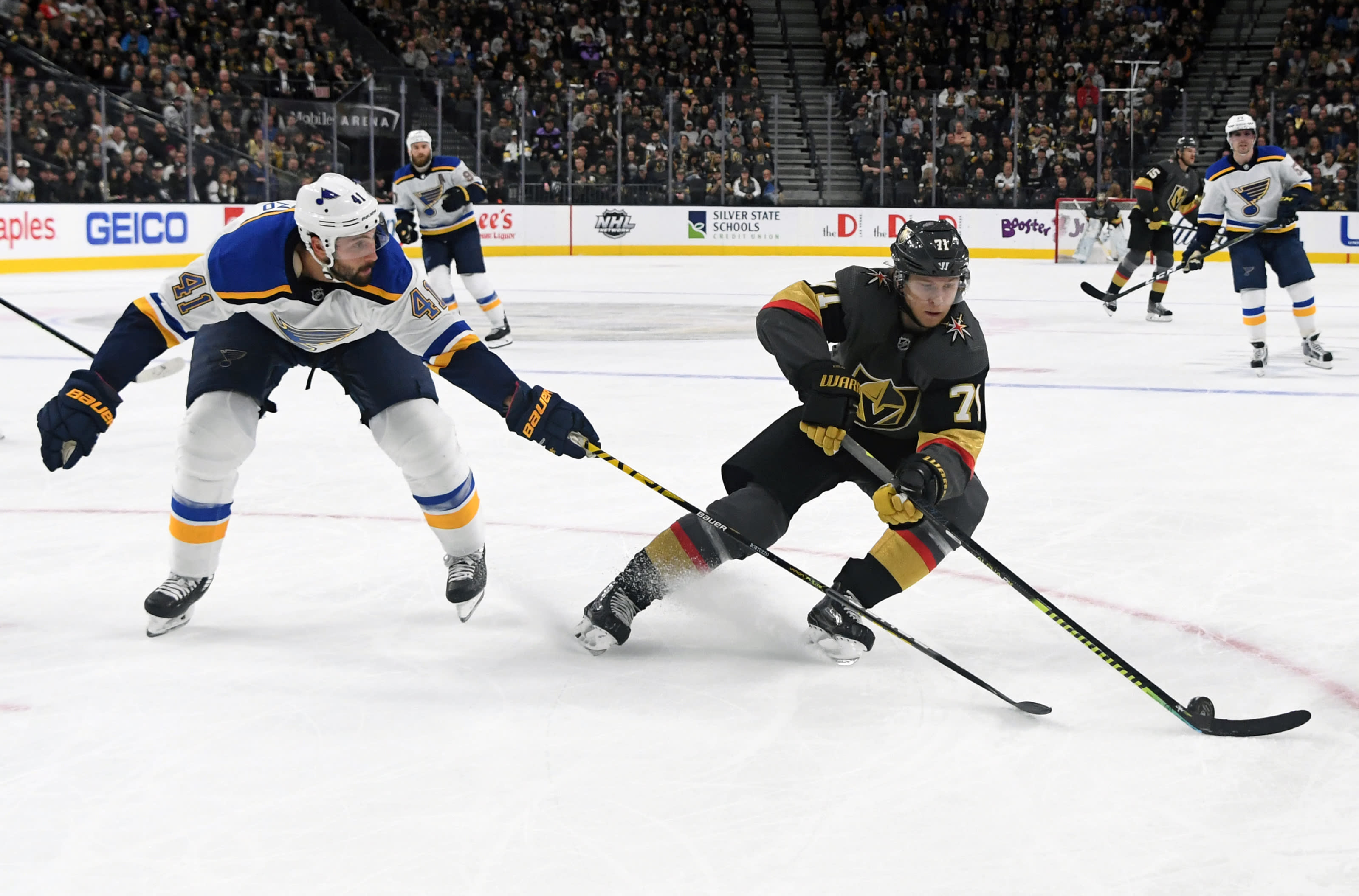 William Karlsson #71 of the Vegas Golden Knights skates with the puck against Robert Bortuzzo #41 of the St. Louis Blues.
