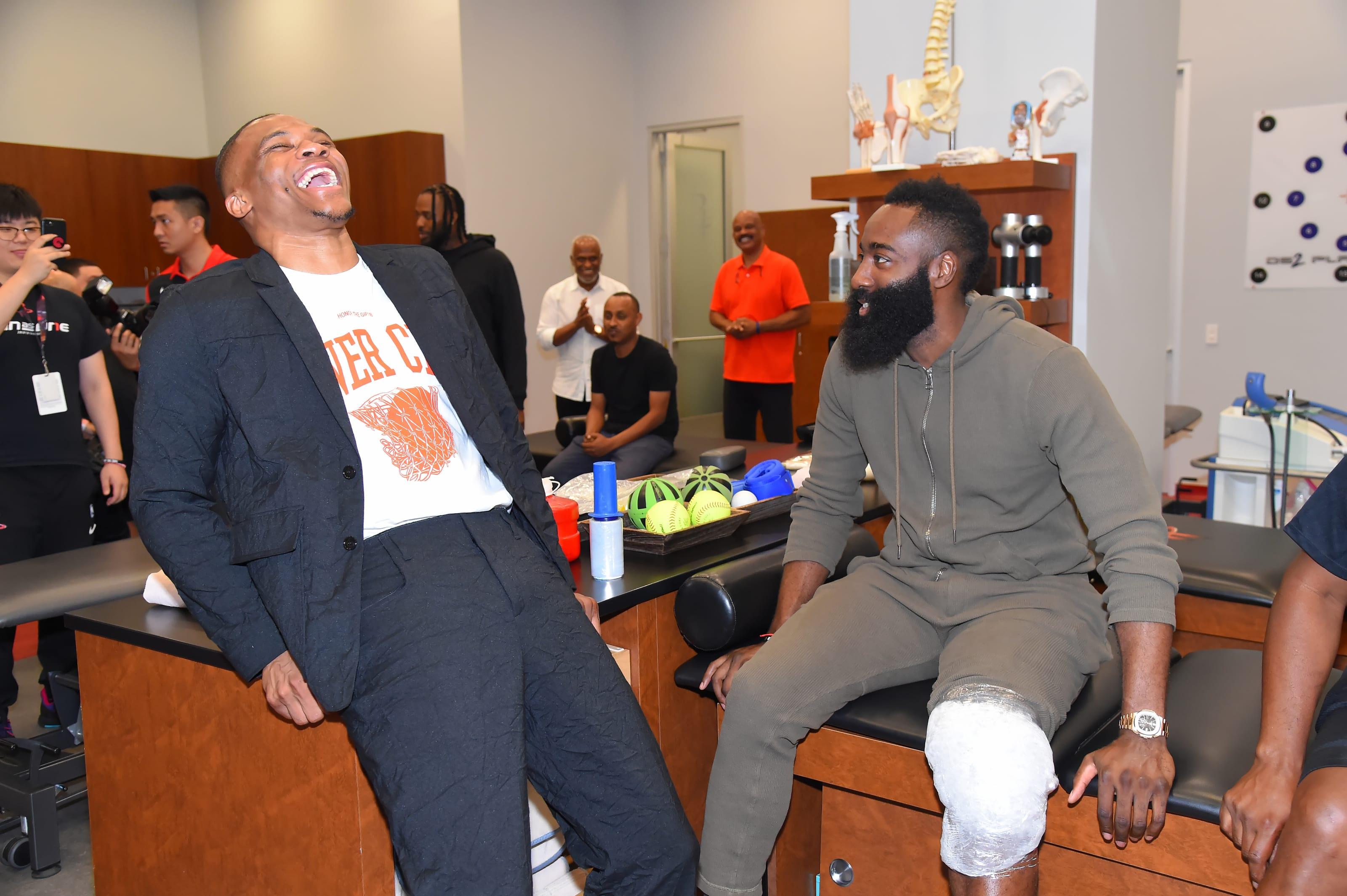 Russell Westbrook #0 of the Houston Rockets talks with James Harden #13 of the Houston Rockets