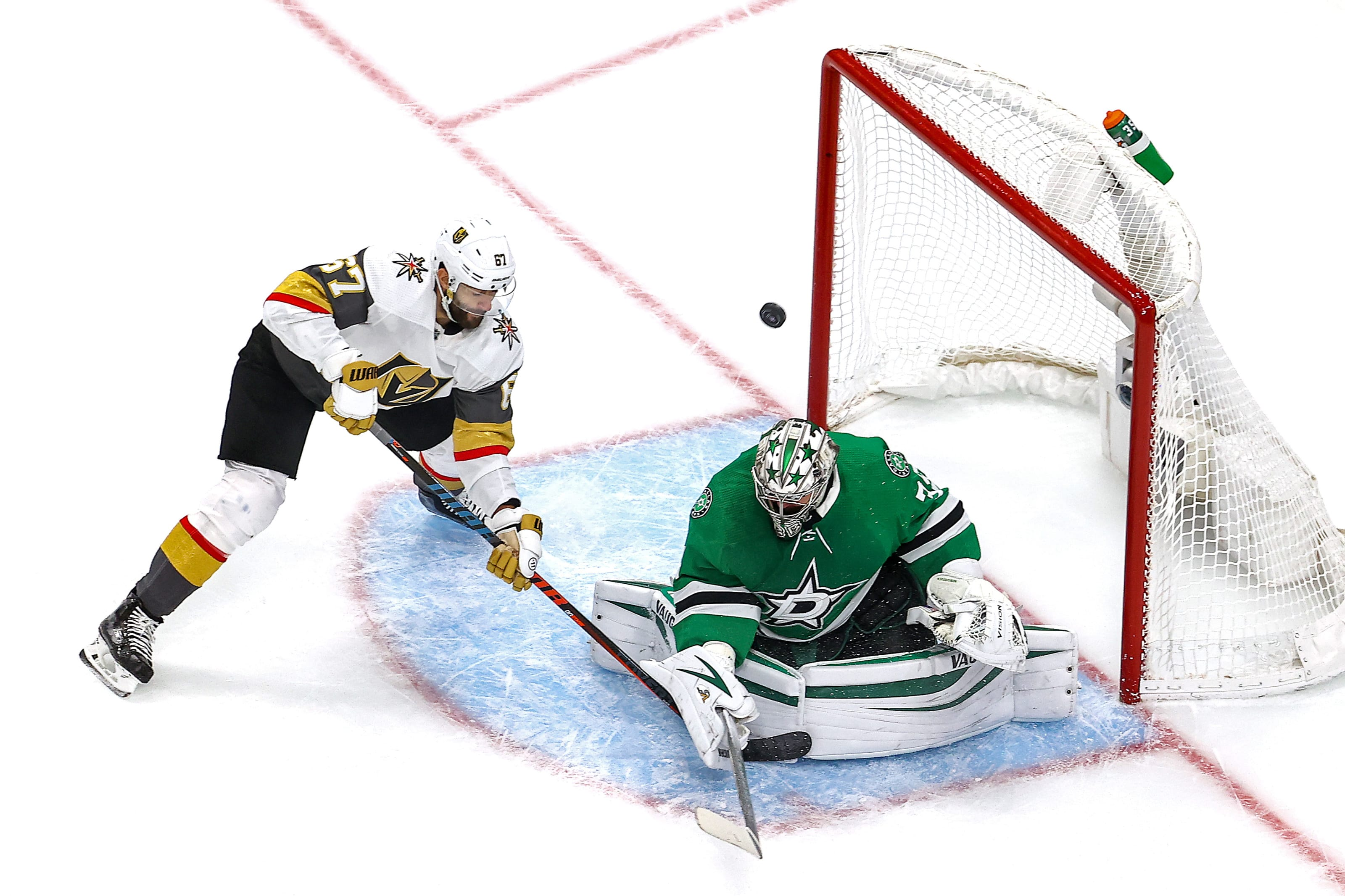Max Pacioretty #67 of the Vegas Golden Knights attempts a shot against Anton Khudobin #35 of the Dallas Stars