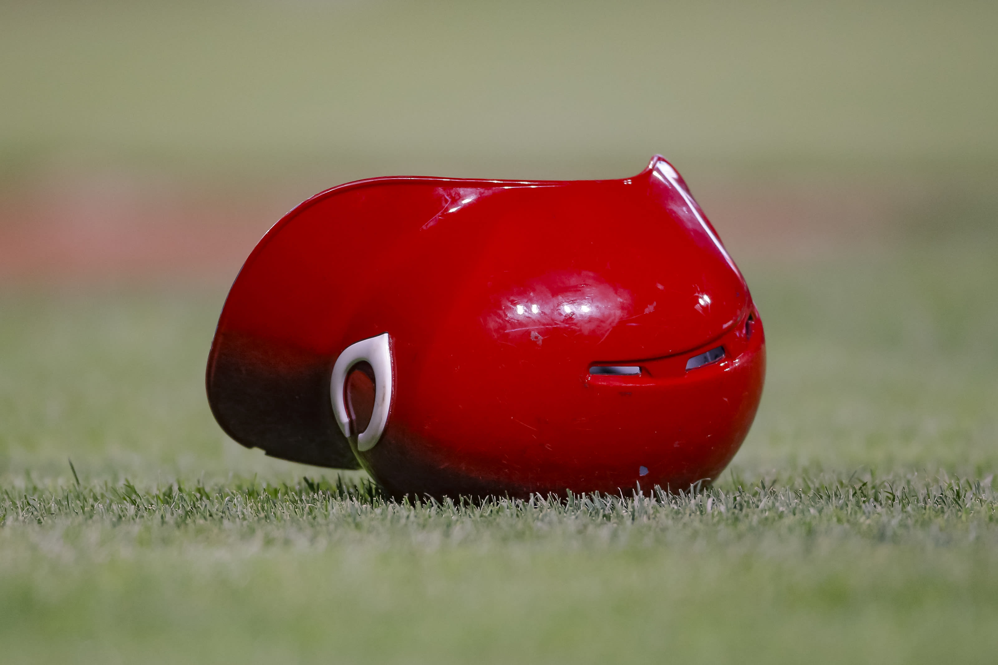 A Cincinnati Reds helmet is seen on the ground during the game.