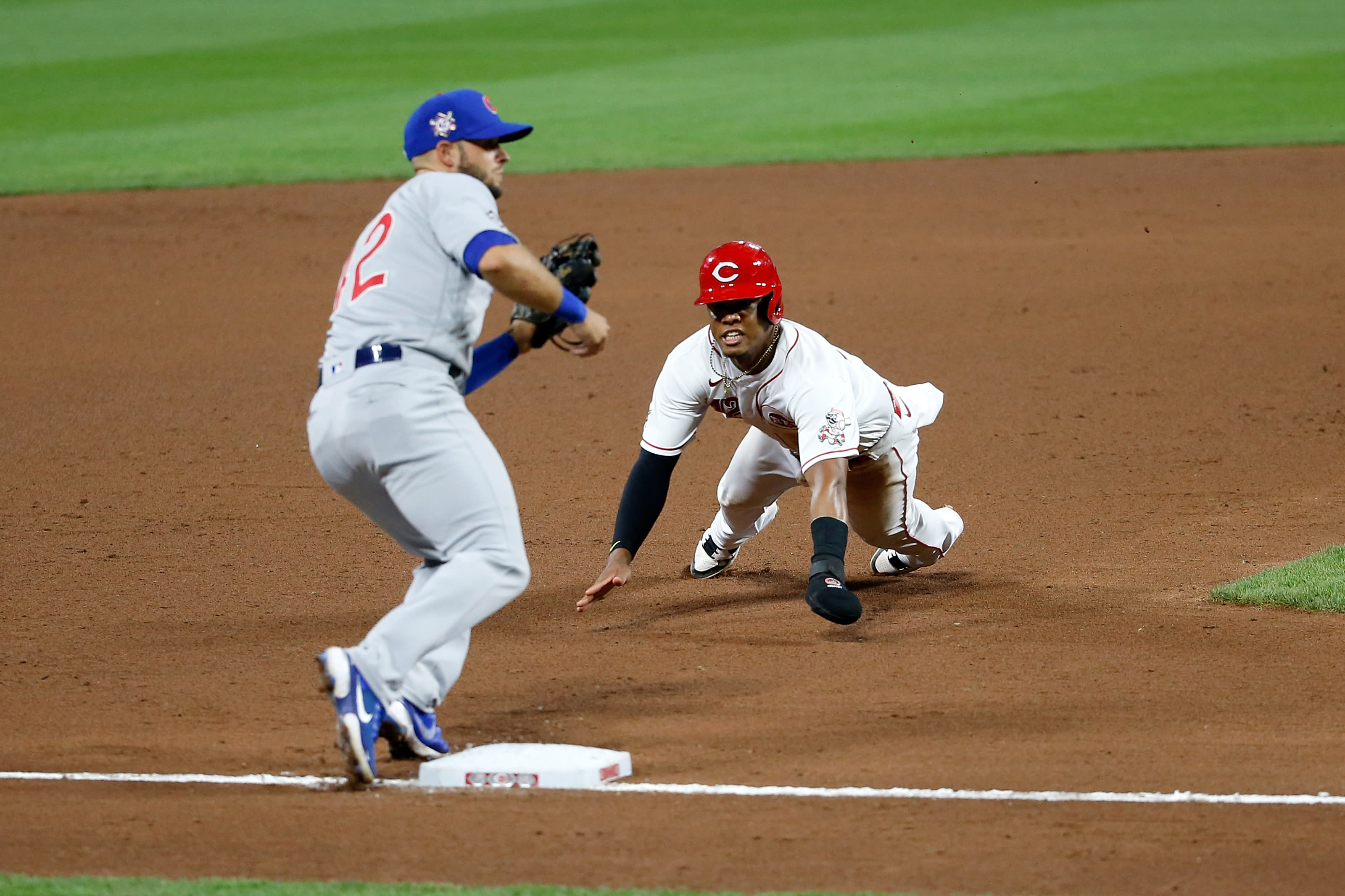 Jose Garcia #42 of the Cincinnati Reds attempts to beat the throw to David Bote #42 of the Chicago Cubs.