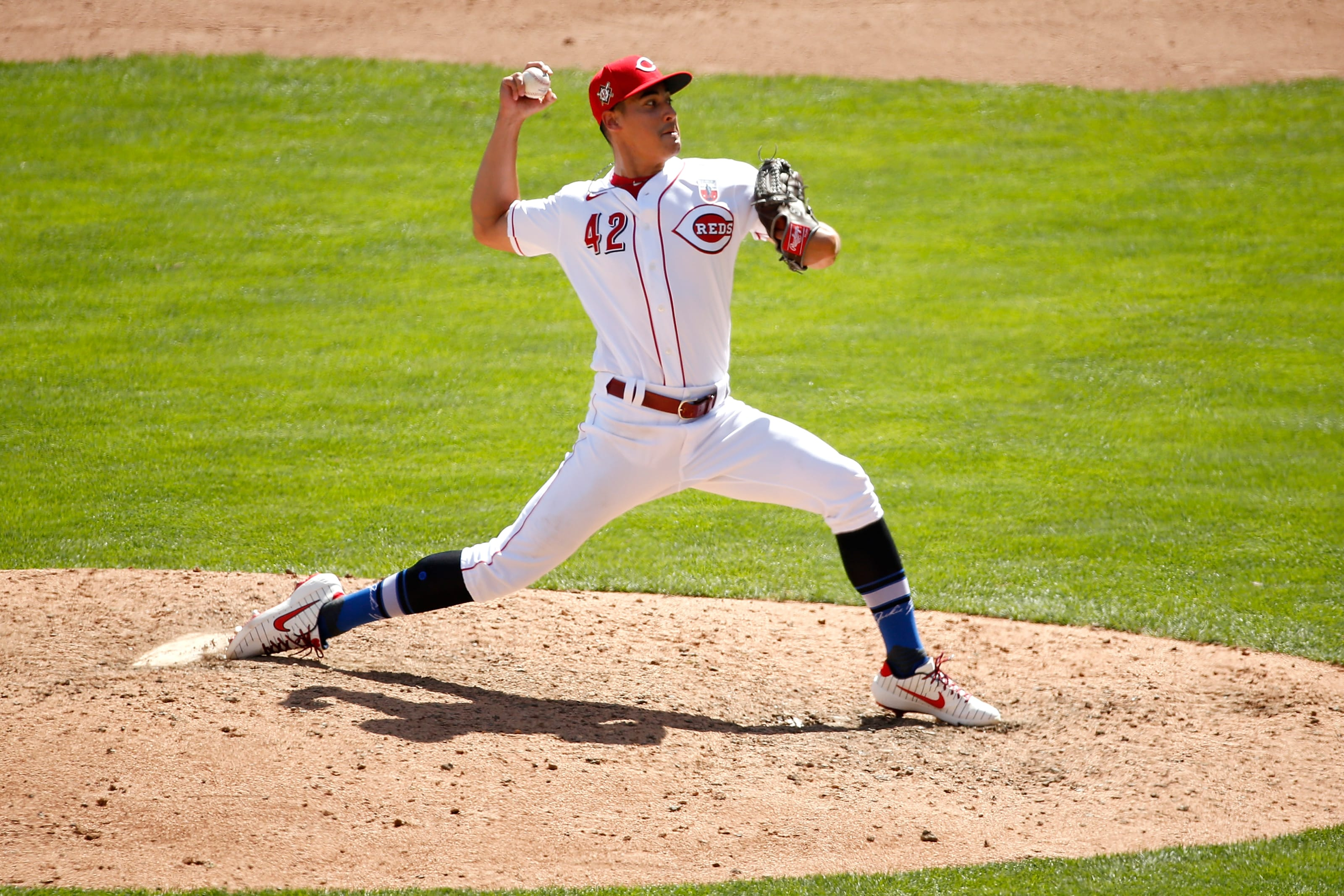 Robert Stephenson #42 of the Cincinnati Reds pitches during the game against the Chicago Cubs.