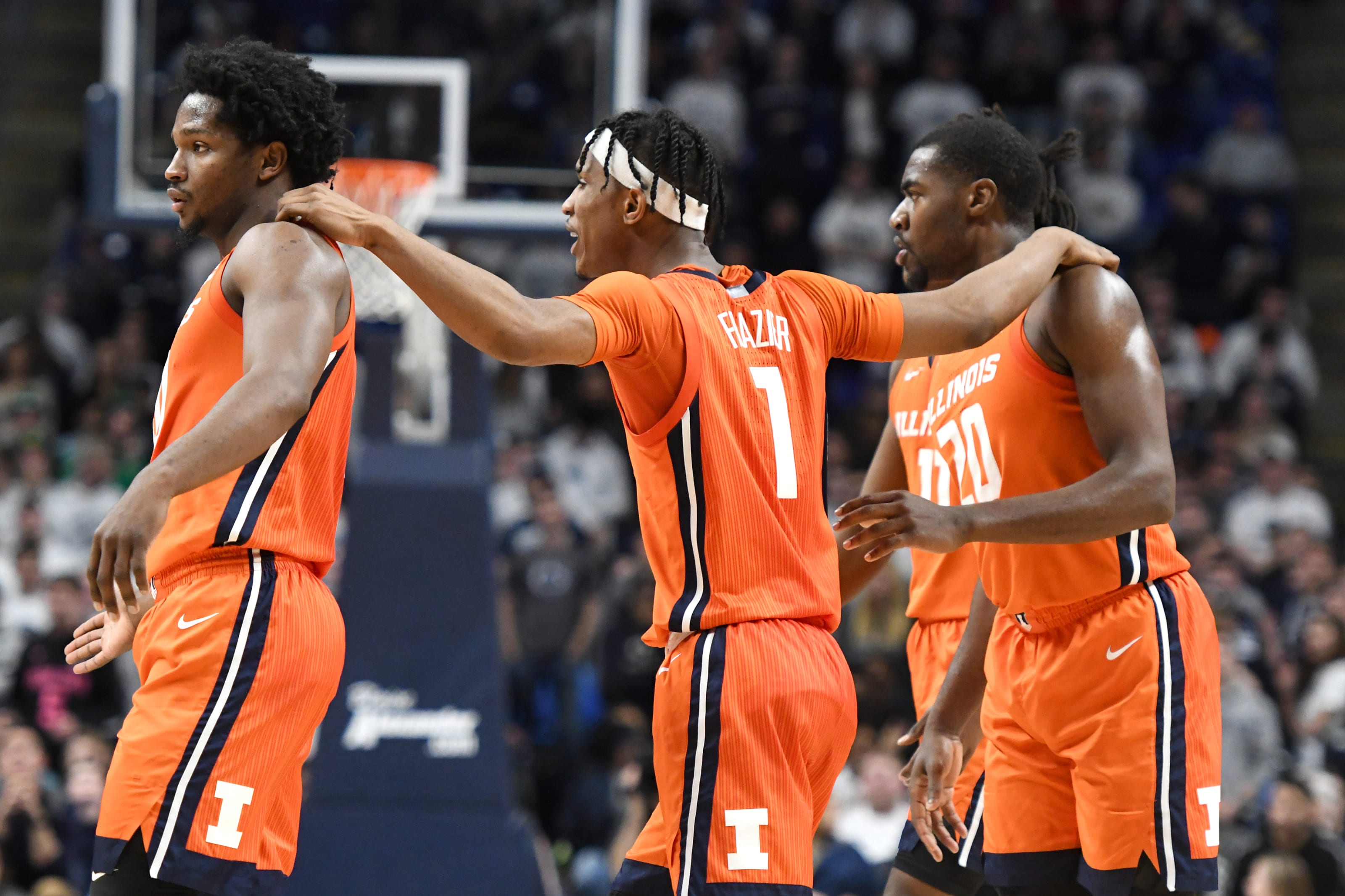 Illini players gather after a play at Penn State