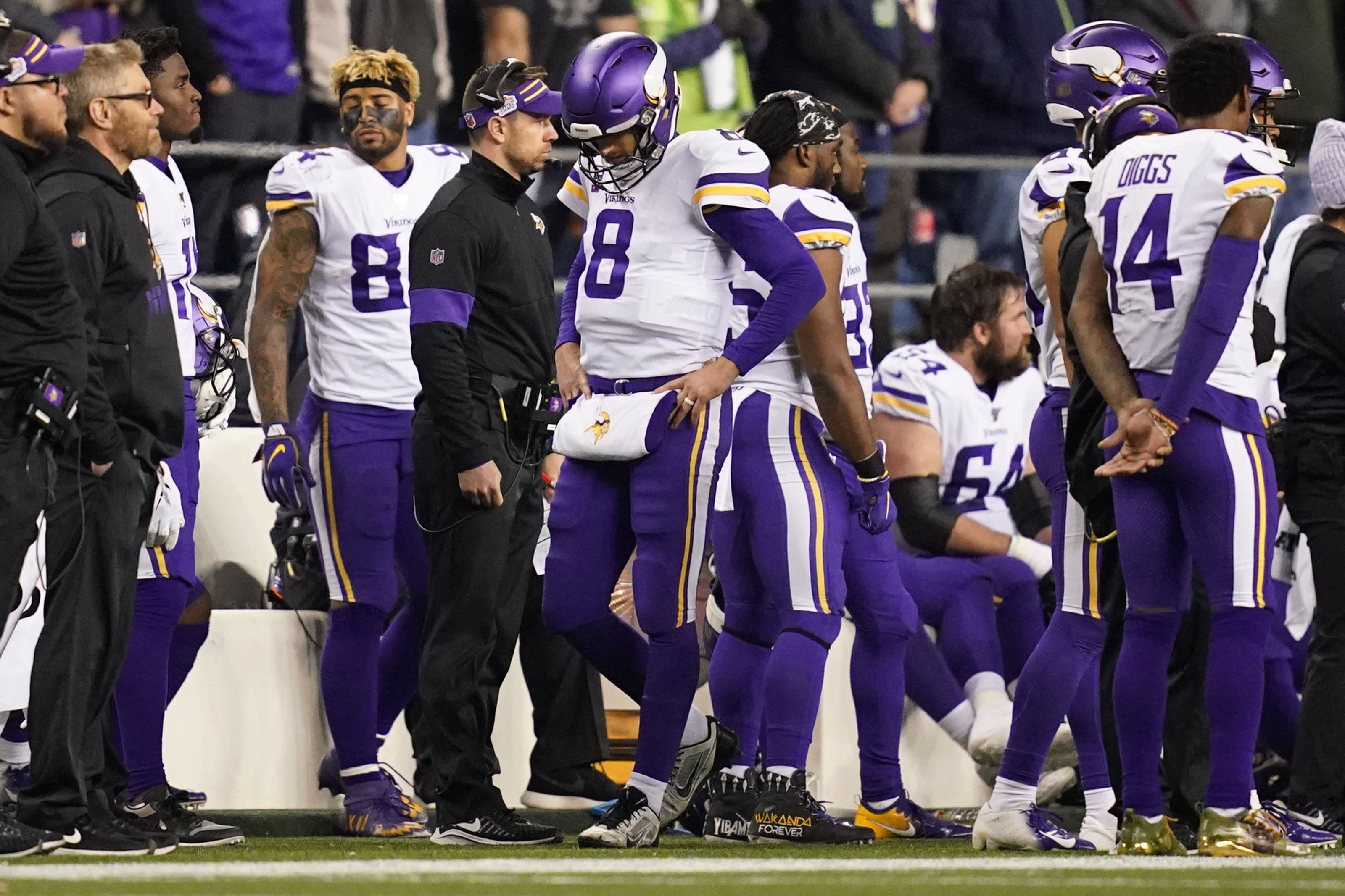 SEATTLE, WA - DECEMBER 2: Vikings quarterback Kirk Cousins (8) paced the sidelines after a turnover on downs in the fourth quarter of an NFL football game in Seattle, Washington. (Photo by Anthony Souffle/Star Tribune via Getty Images)