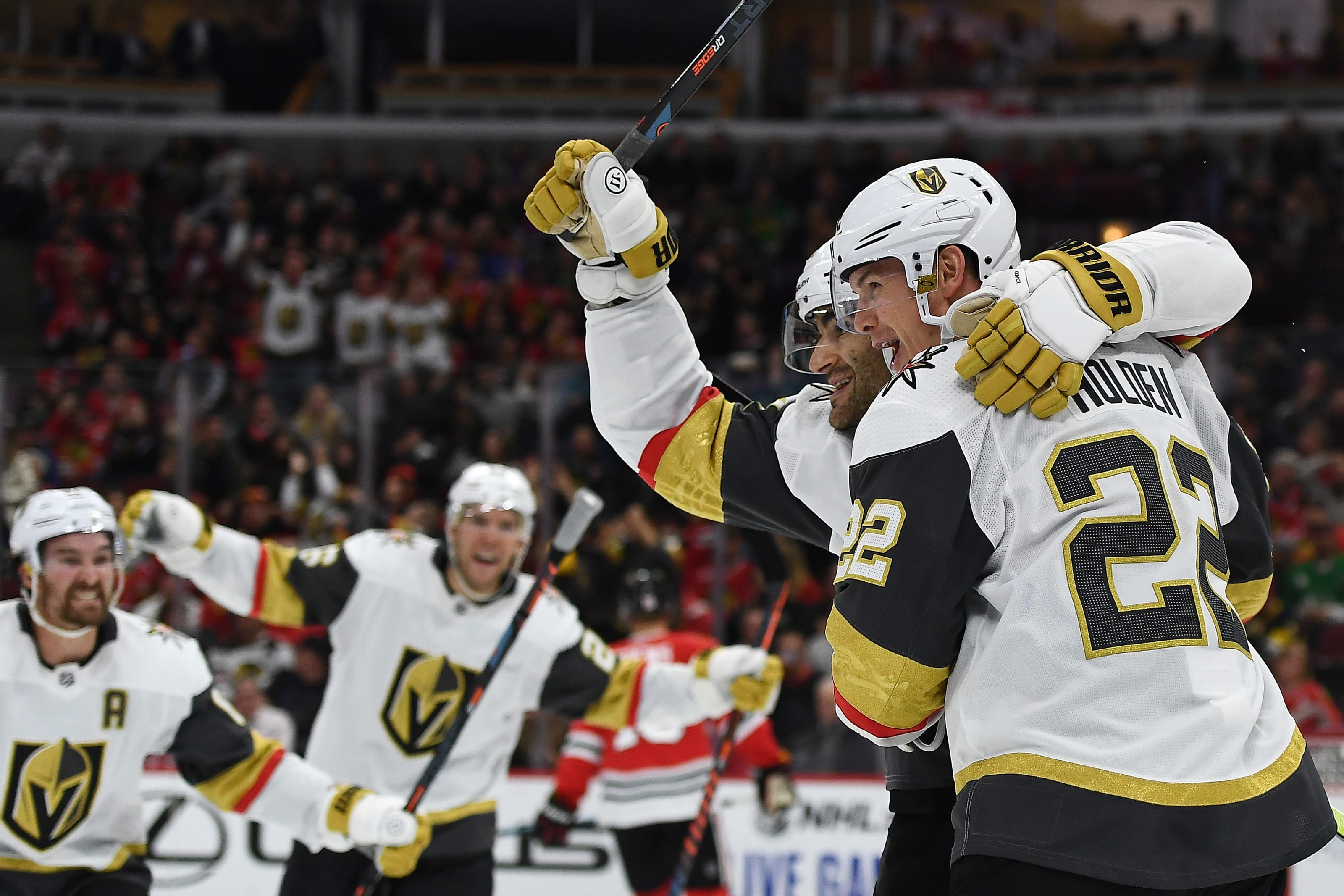 Nick Holden #22 of the Vegas Golden Knights celebrates a goal with Max Pacioretty #67.