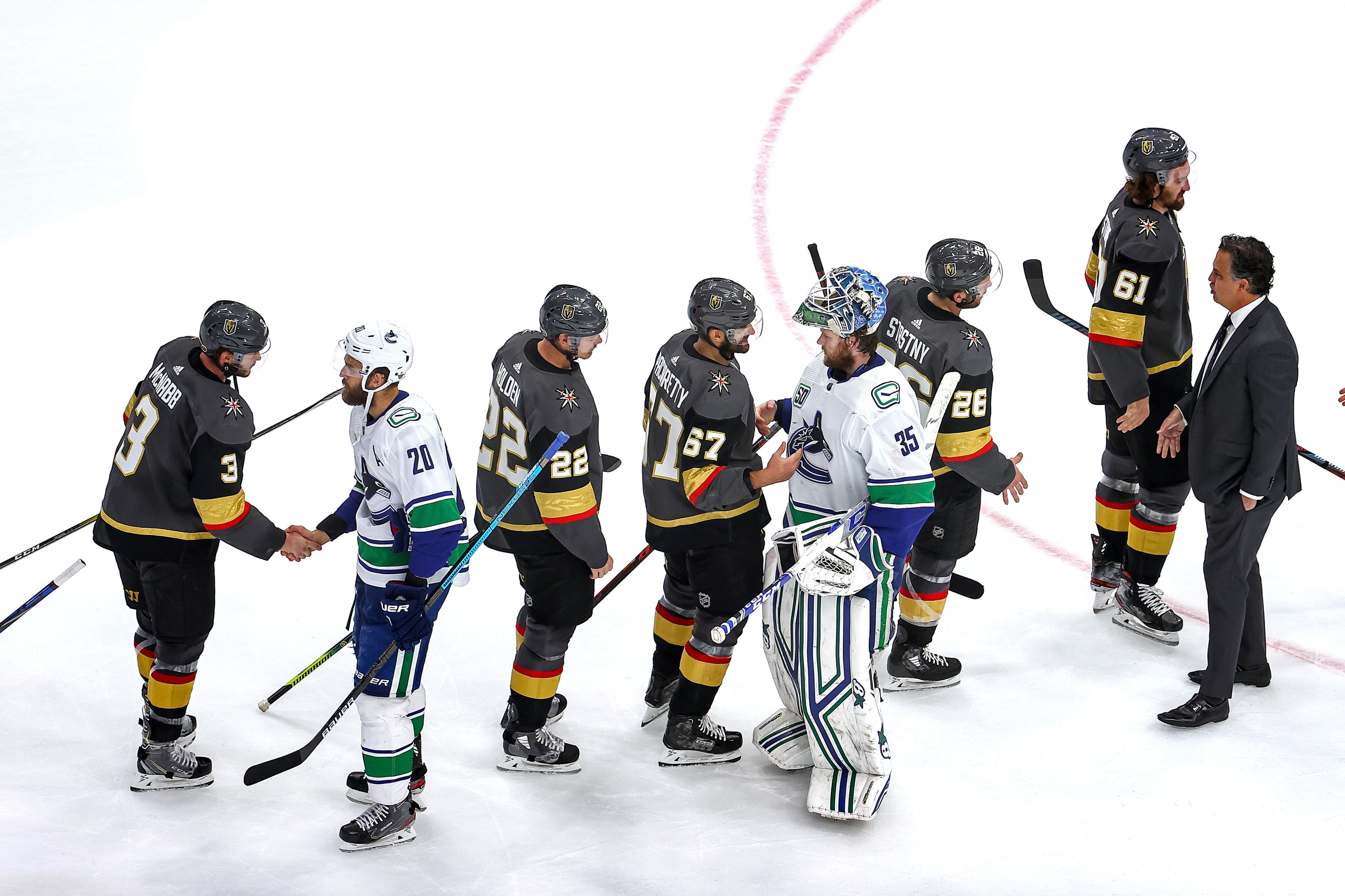 The Vancouver Canucks and Vegas Golden Knights shake hands following the Golden Knights 3-0 win in Game Seven