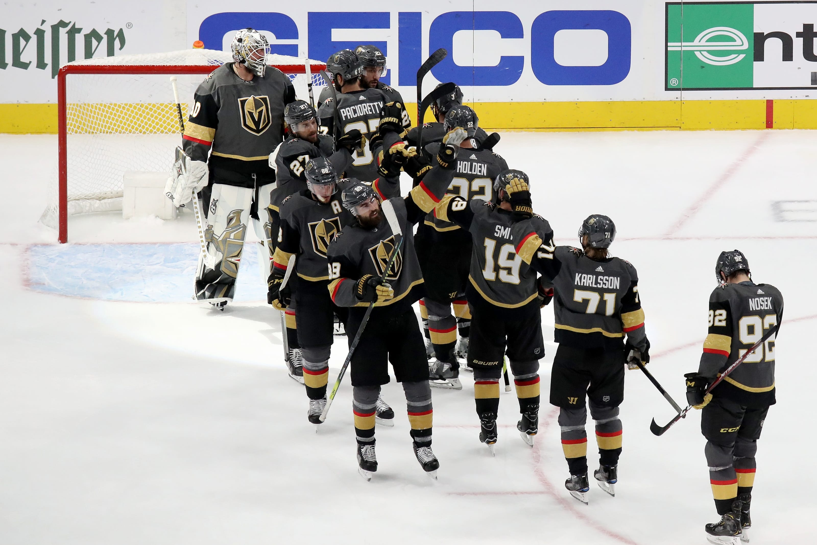 Robin Lehner #90 of the Vegas Golden Knights celebrates with his teammates after defeating the Dallas Stars in Game Two