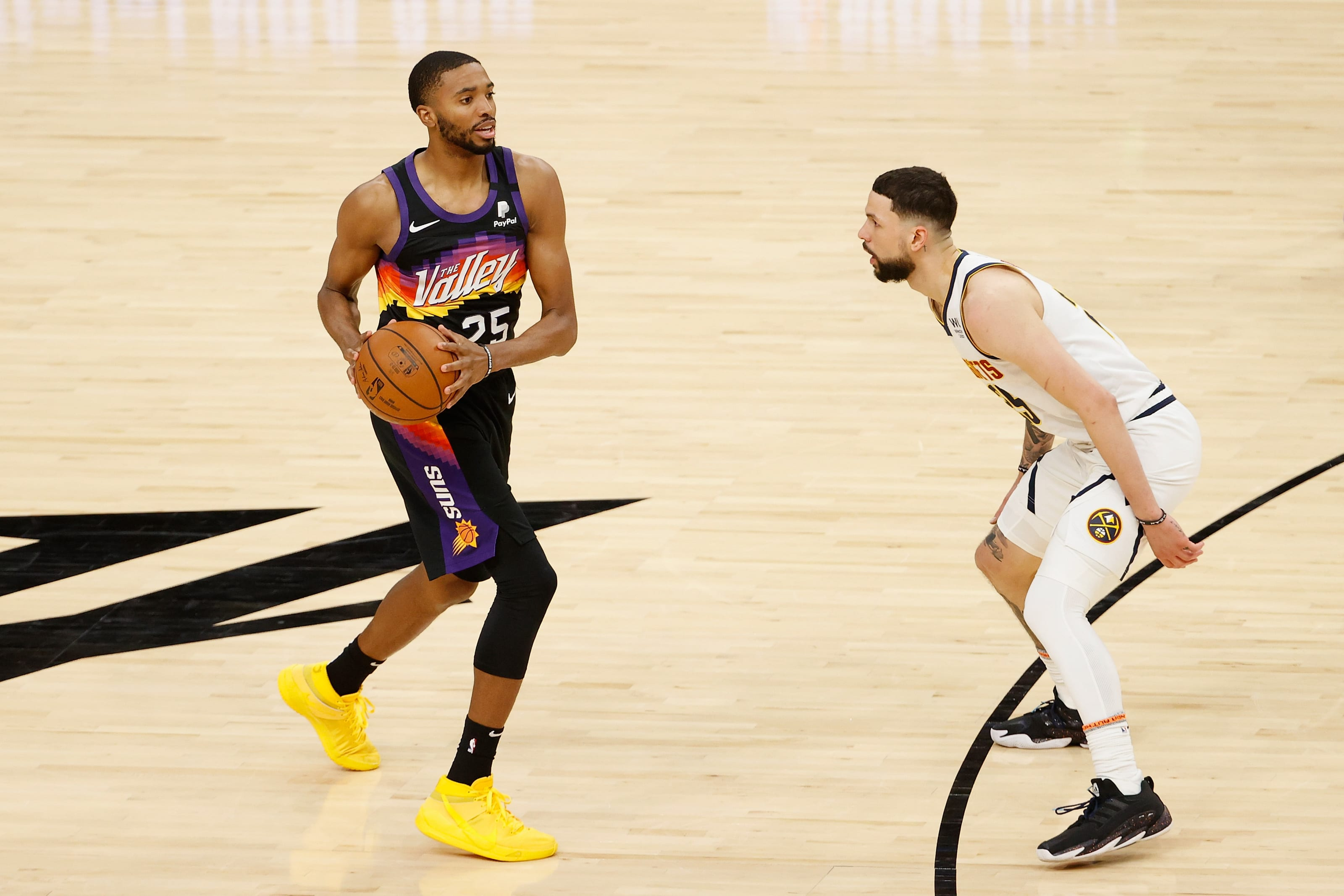 Mikal Bridges, Phoenix Suns looks to pass around Austin Rivers, Denver Nuggets during the NBA Playoffs. (Photo by Christian Petersen/Getty Images)