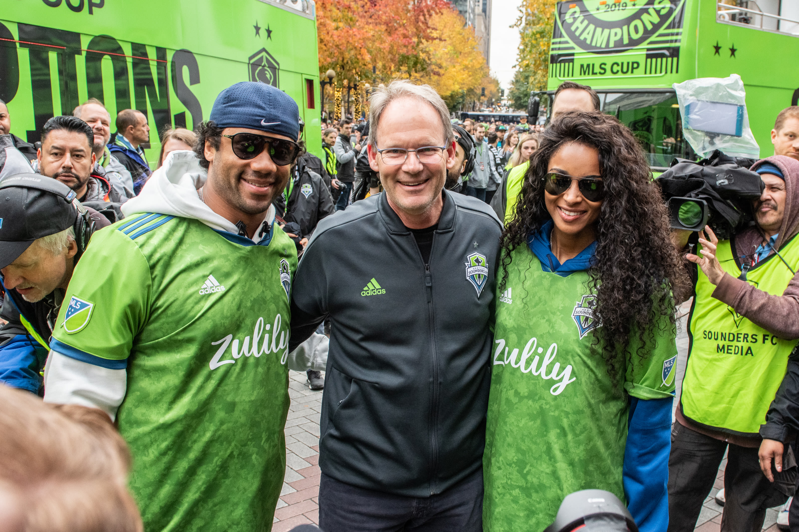Russell Wilson, Ciara and Brian Schmetzer of the Seattle Sounders celebrate. Ken Griffey Jr. family will join them in 2021.