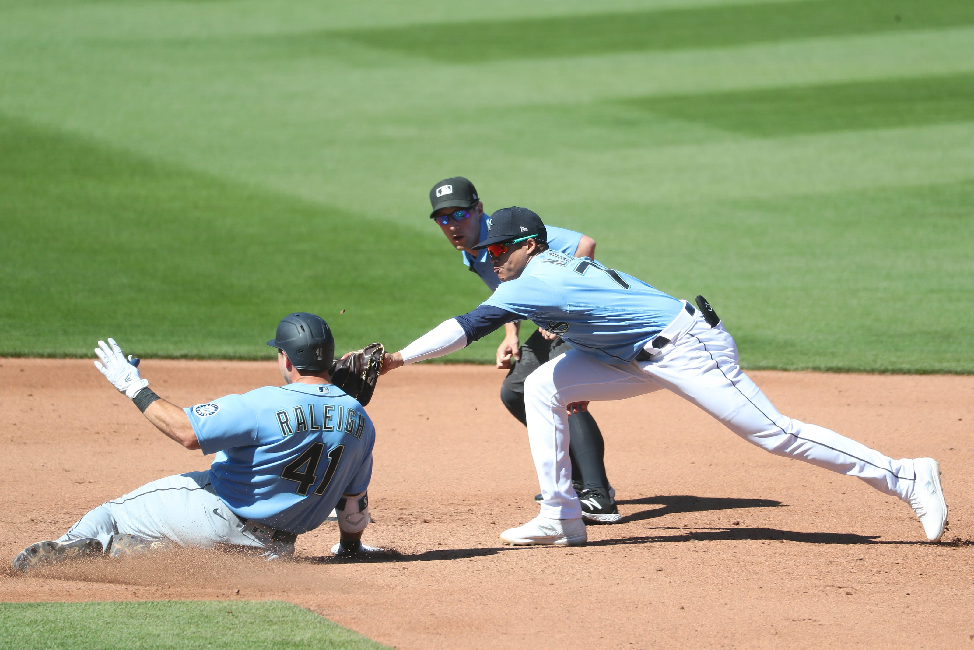 Cal Raleigh is tagged out by Noelvi Marte. Both were playing in Seattle Mariners Instructional League.
