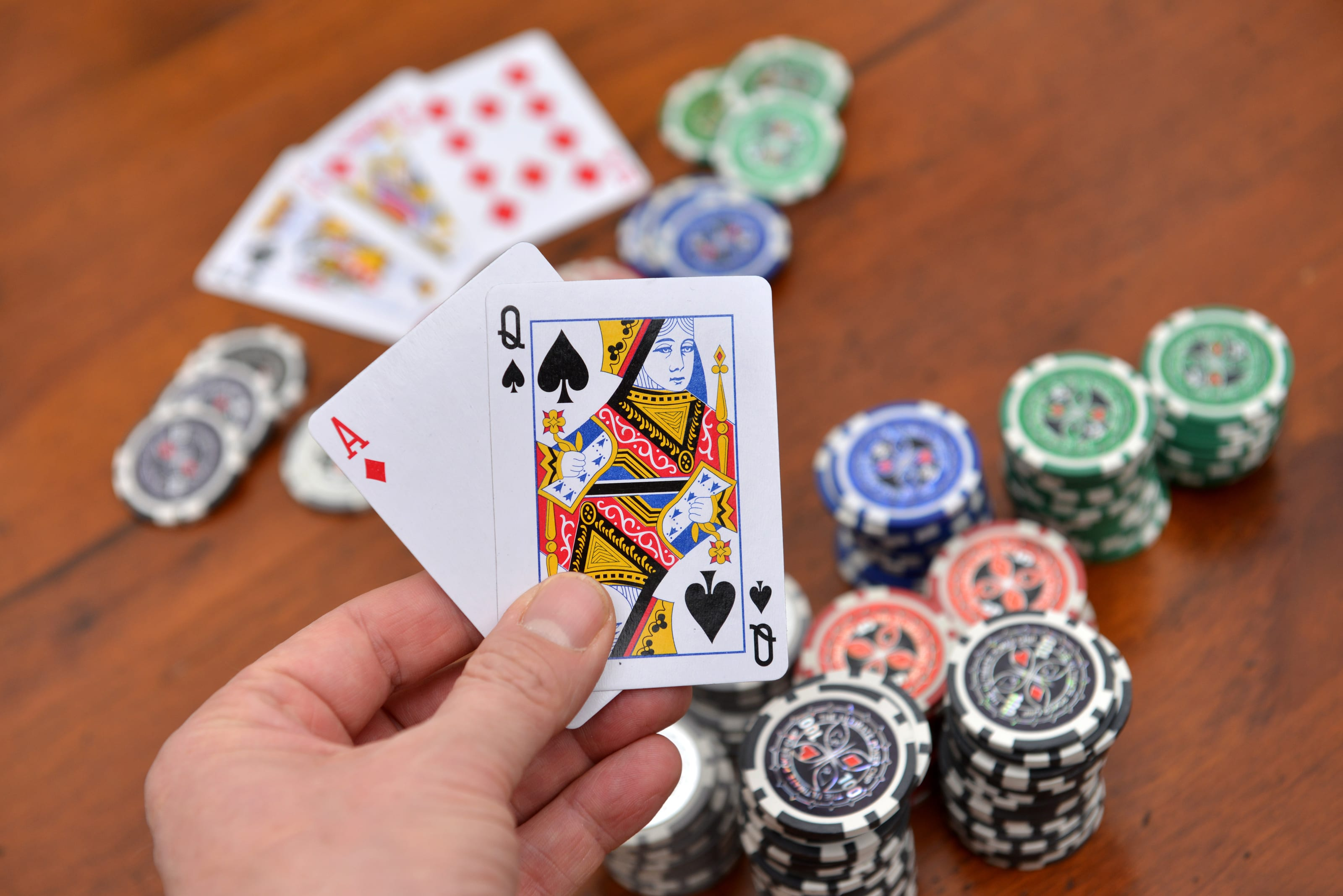 Poker hand facing with cards down and chips
