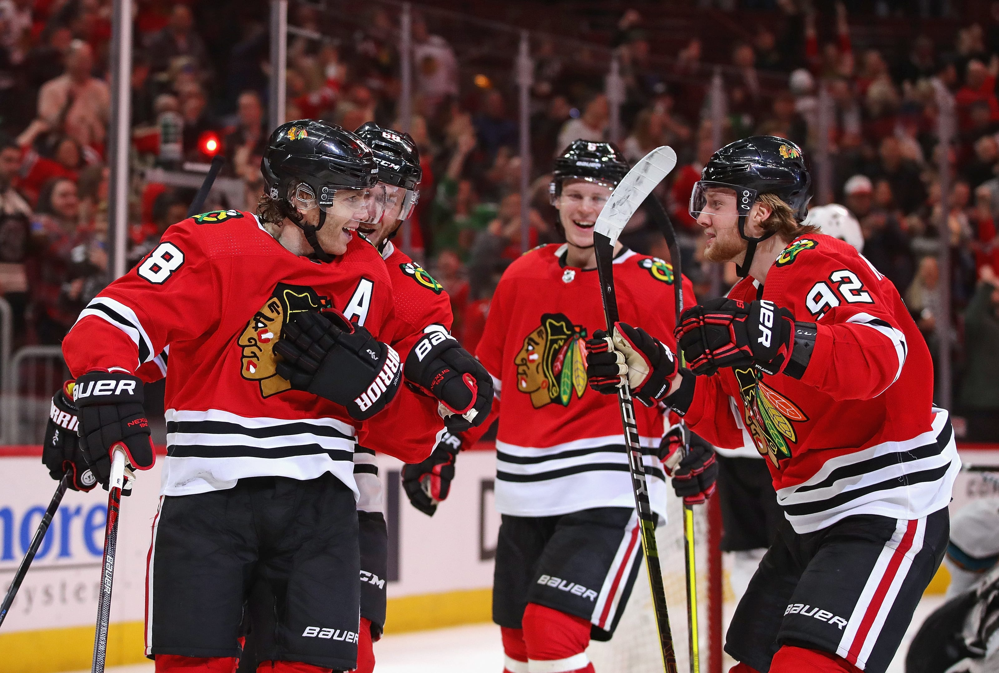 Patrick Kane #88 of the Chicago Blackhawks (L) celebrates his second goal of the game
