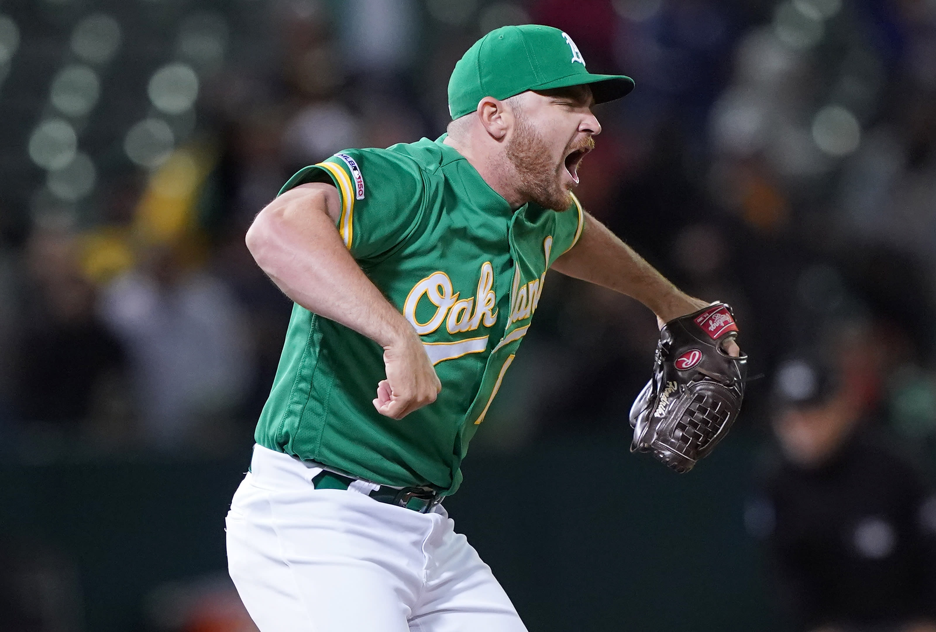 Liam Hendriks, a free-agent, celebrates an A's win. Hendriks is a potential Seattle Mariners target.