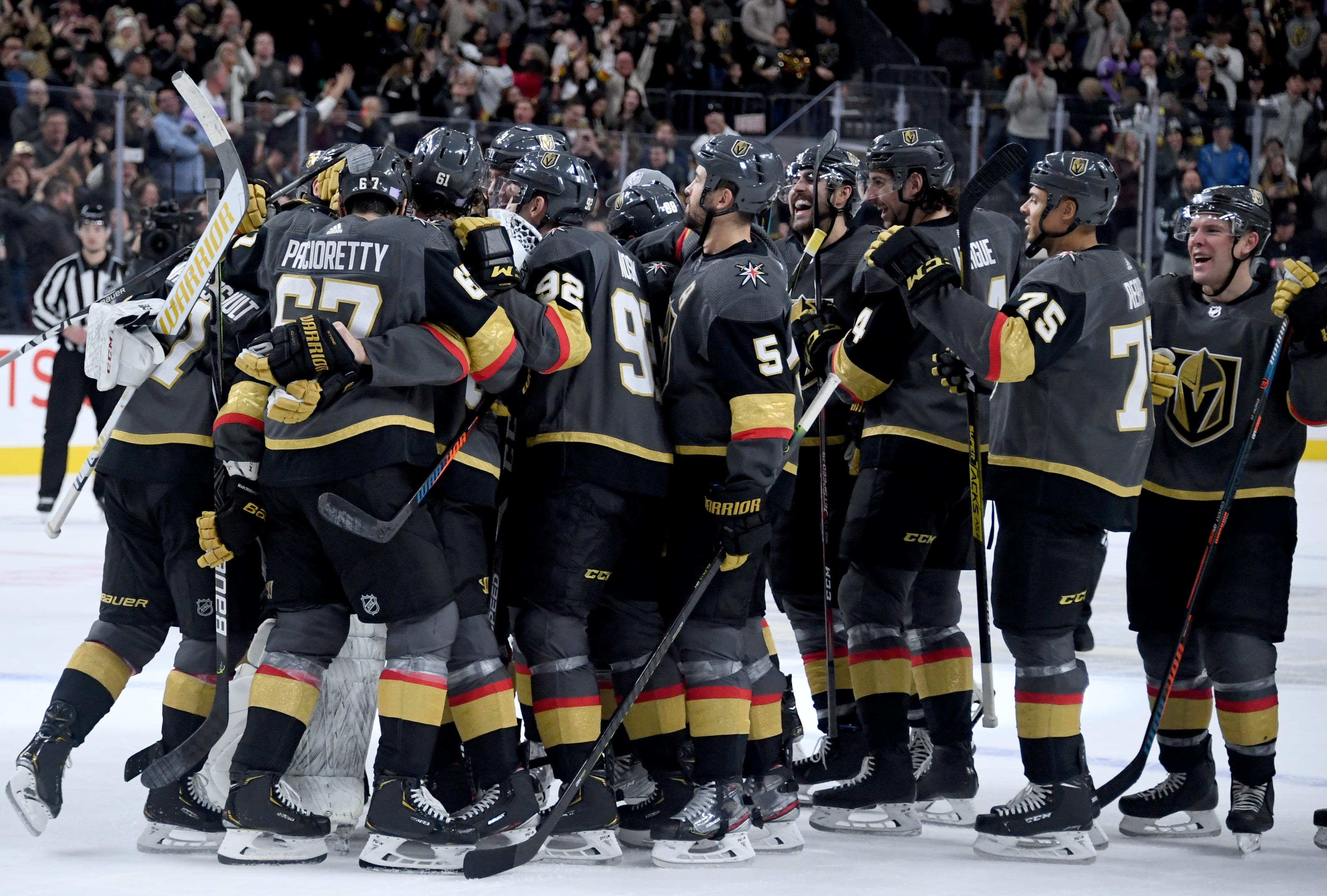 The Vegas Golden Knights celebrate their 2-1 shootout victory over the Arizona Coyotes.