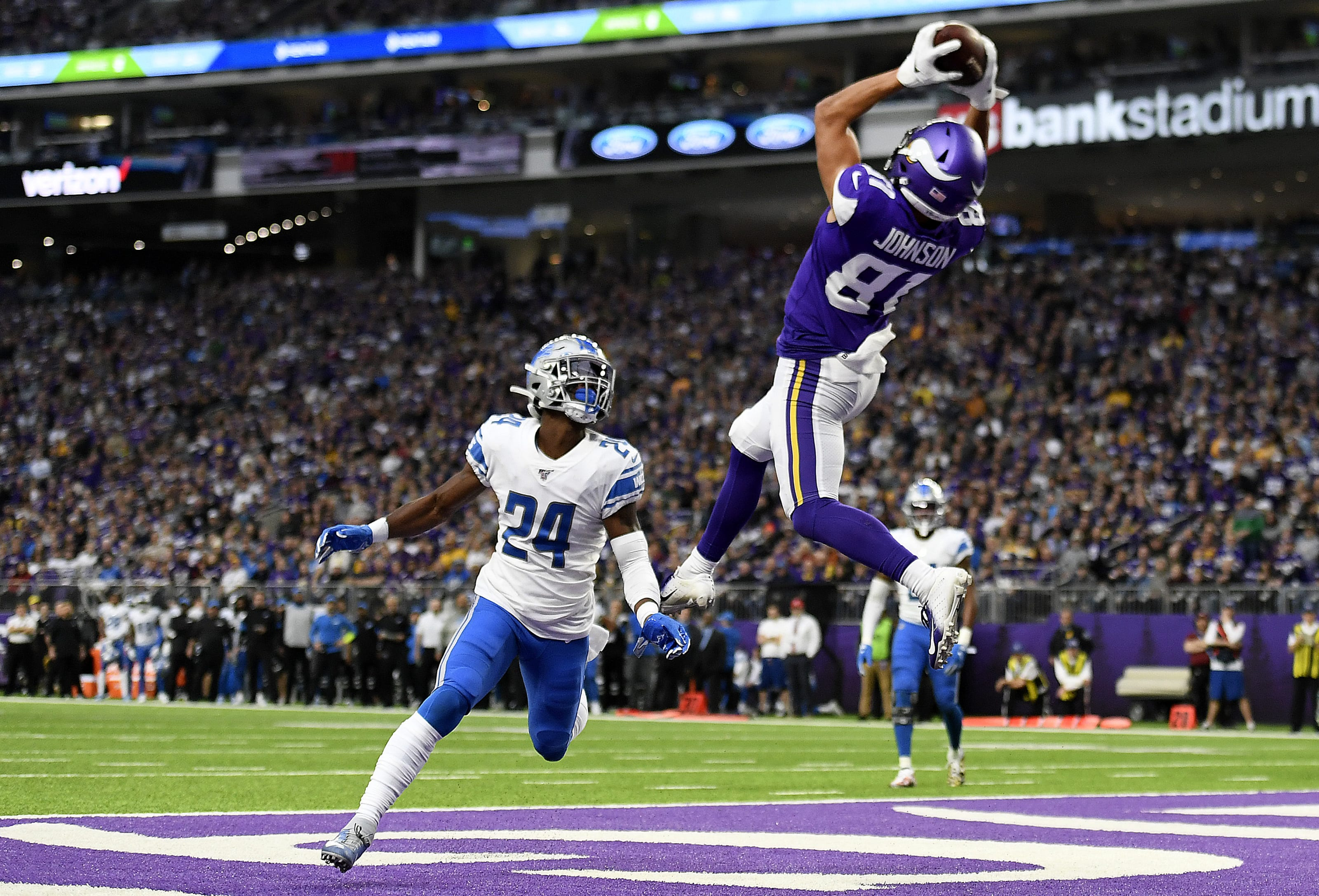 MINNEAPOLIS, MINNESOTA - DECEMBER 08: Minnesota Vikings wide receiver Bisi Johnson #81 catches a pass for a touchdown as Detroit Lions cornerback Amani Oruwariye #24 defends during the first quarter at U.S. Bank Stadium on December 08, 2019 in Minneapolis, Minnesota. (Photo by Hannah Foslien/Getty Images)