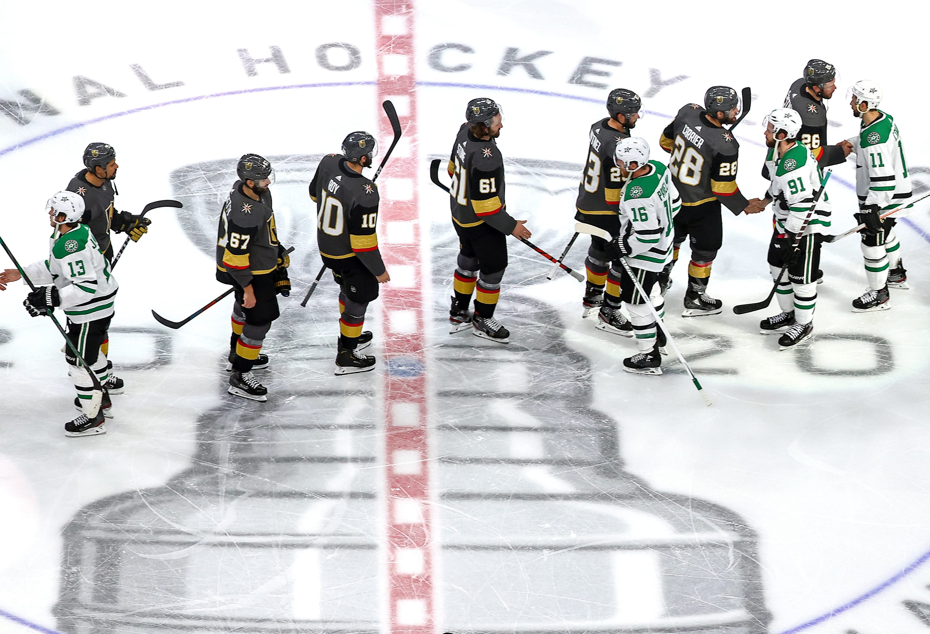 The Vegas Golden Knights and the Dallas Stars shake hands following the Stars 3-2 overtime victory in Game Five