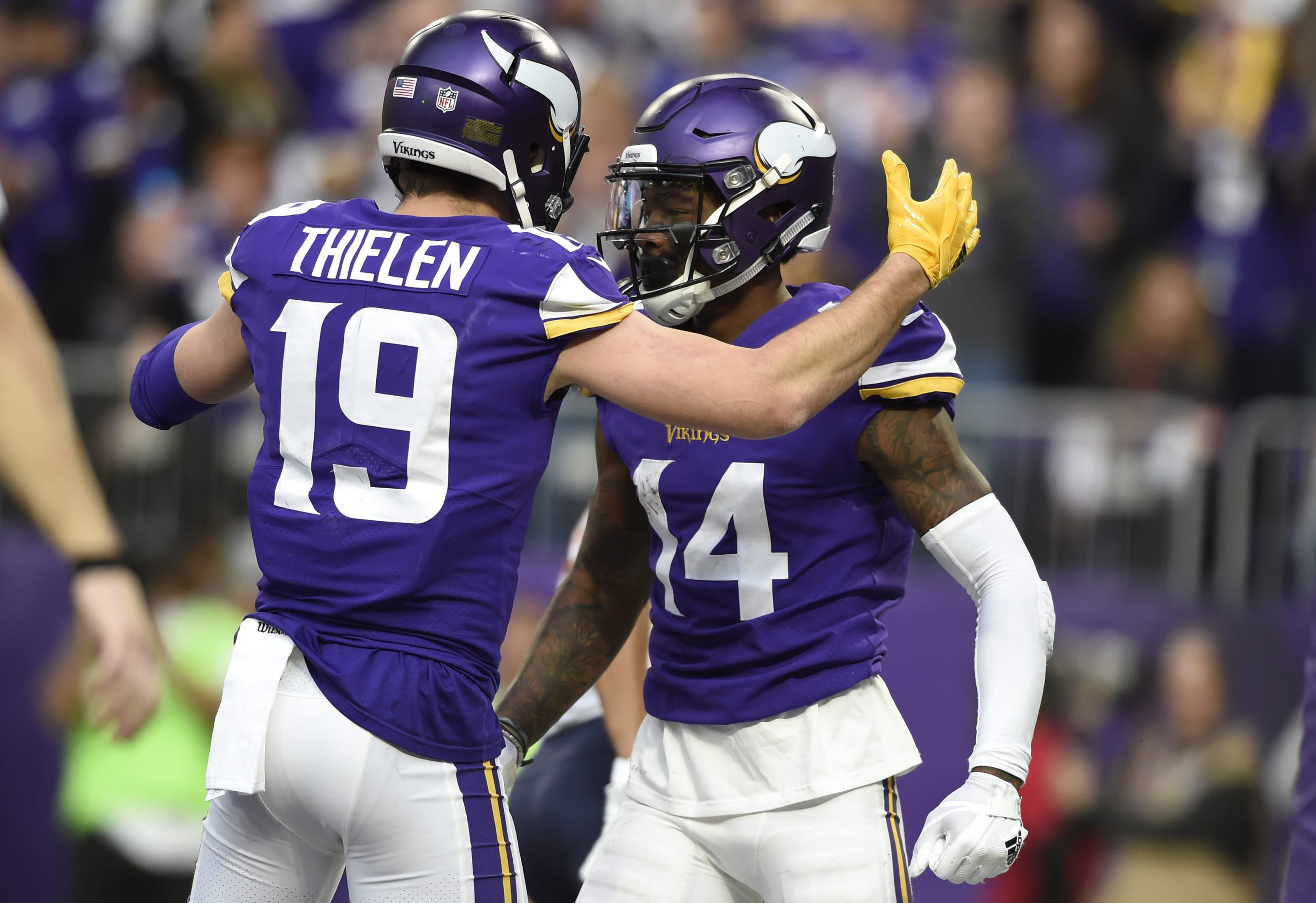 MINNEAPOLIS, MN - DECEMBER 31: Stefon Diggs #14 of the Minnesota Vikings celebrates with teammate Adam Thielen #19 after scoring a touchdown in the third quarter of the game against the Chicago Bears on December 31, 2017 at U.S. Bank Stadium in Minneapolis, Minnesota. (Photo by Hannah Foslien/Getty Images)