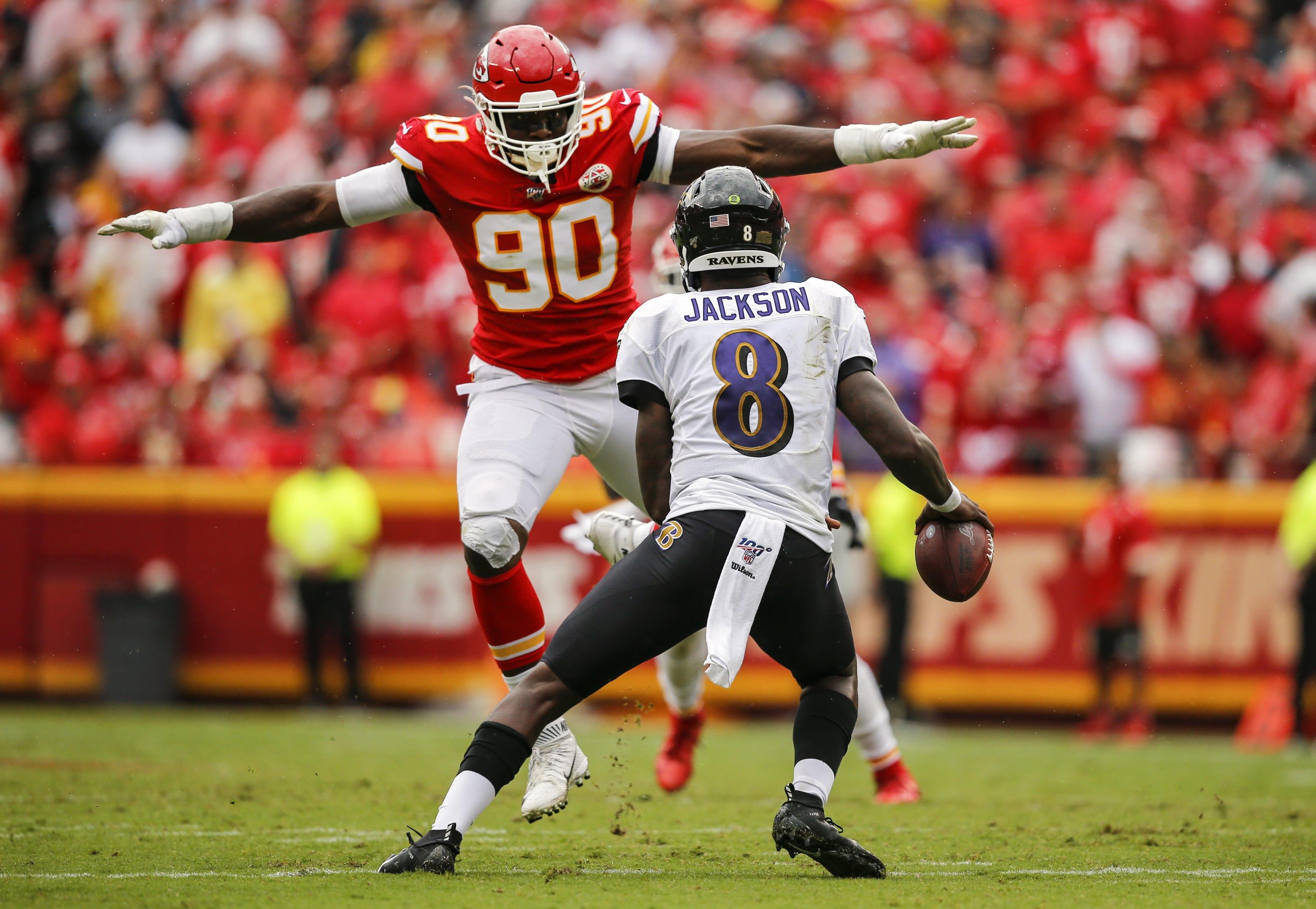 Kansas City Chiefs Defensive End Emmanuel Ogbah jumping at Baltimore Ravens Quarterback Lamar Jackson.