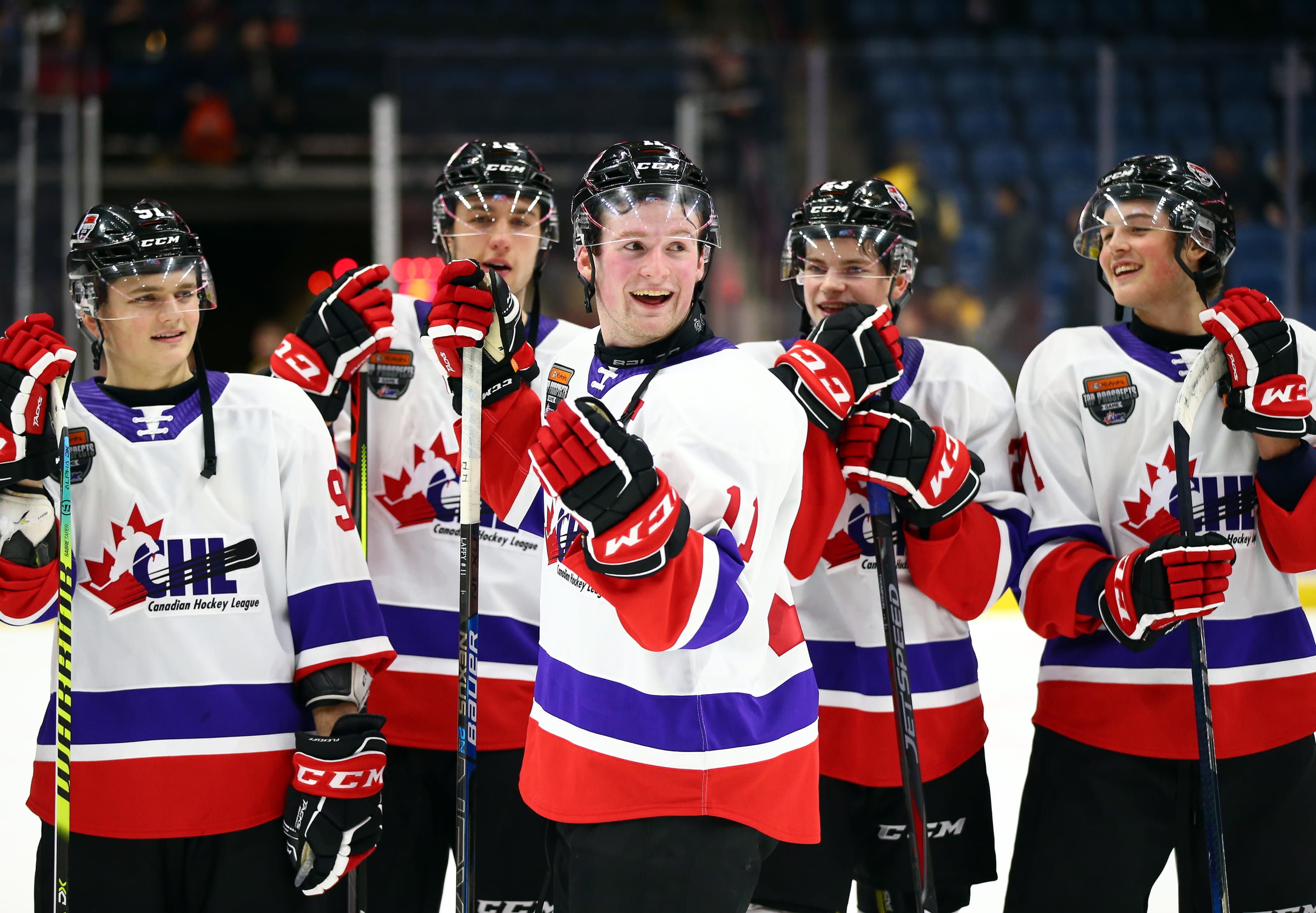 Alexis Lafreniere #11 of Team White laughs with teammates following the final whistle of the 2020 CHL/NHL Top Prospects Game against Team Red.