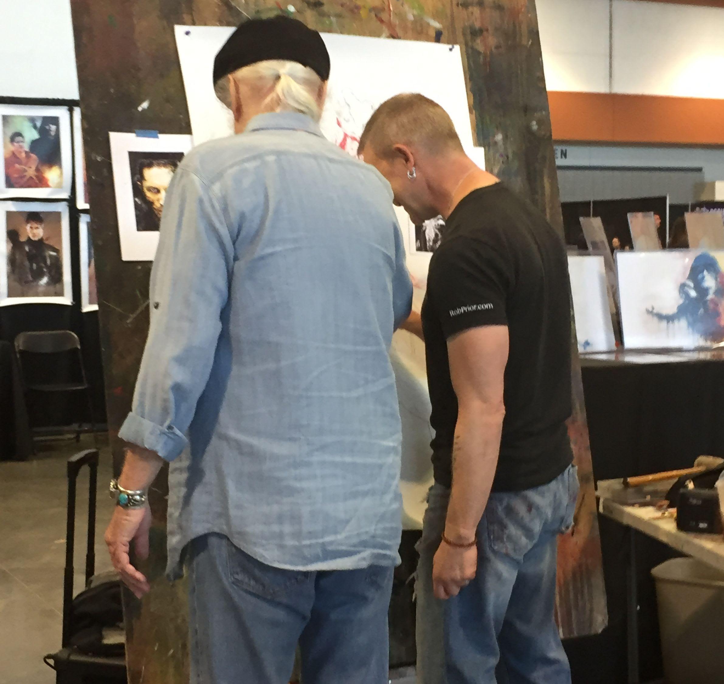 Scott Wilson joins artist Rob Prior at the easel at Walker Stalker Nashville