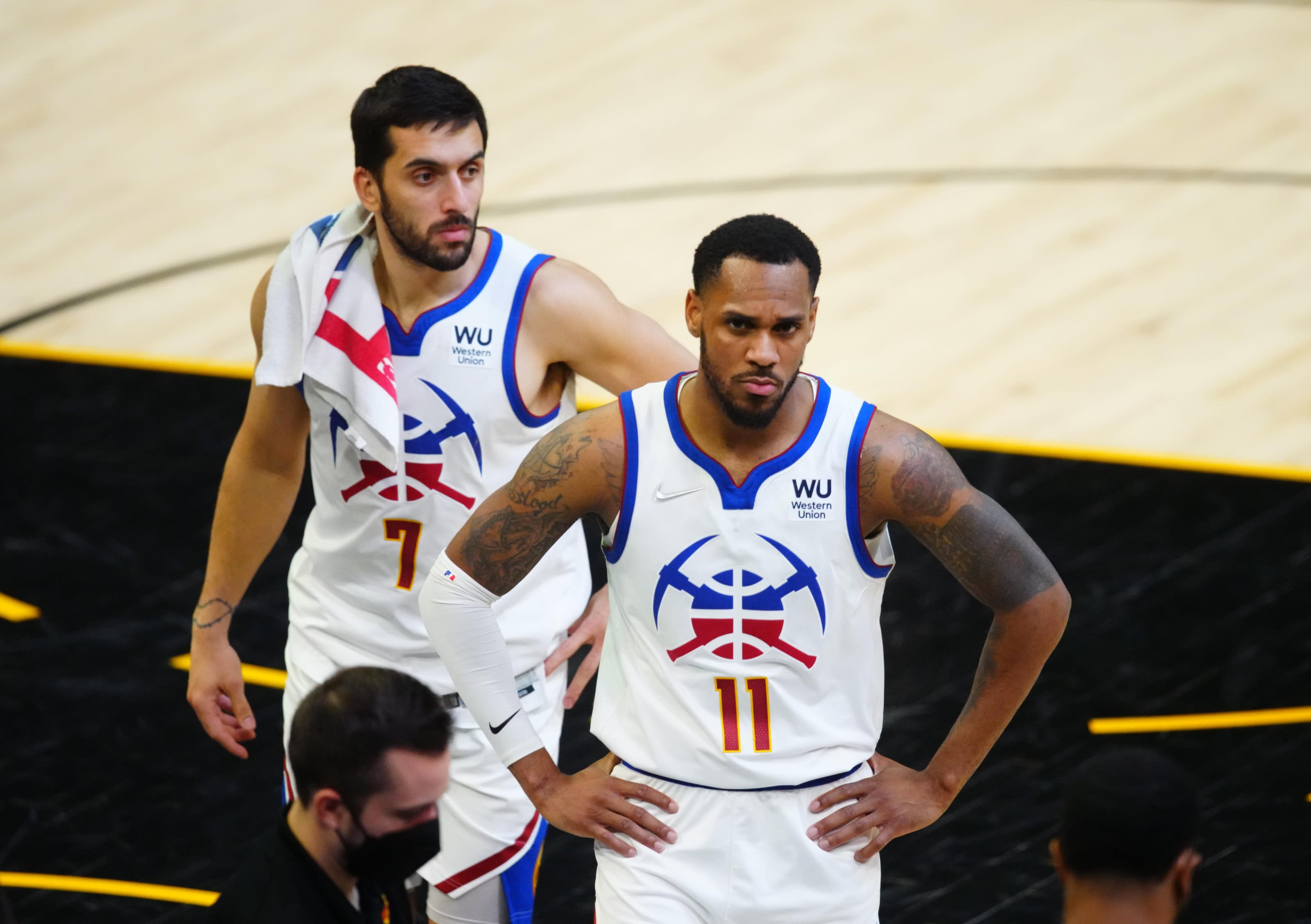 Denver Nuggets guard Monte Morris and guard Facundo Campazzo react against the Phoenix Suns in the second half during Game 2 in the second round of the 2021 NBA Playoffs on 9 Jun. 2021 (Mark J. Rebilas-USA TODAY Sports)