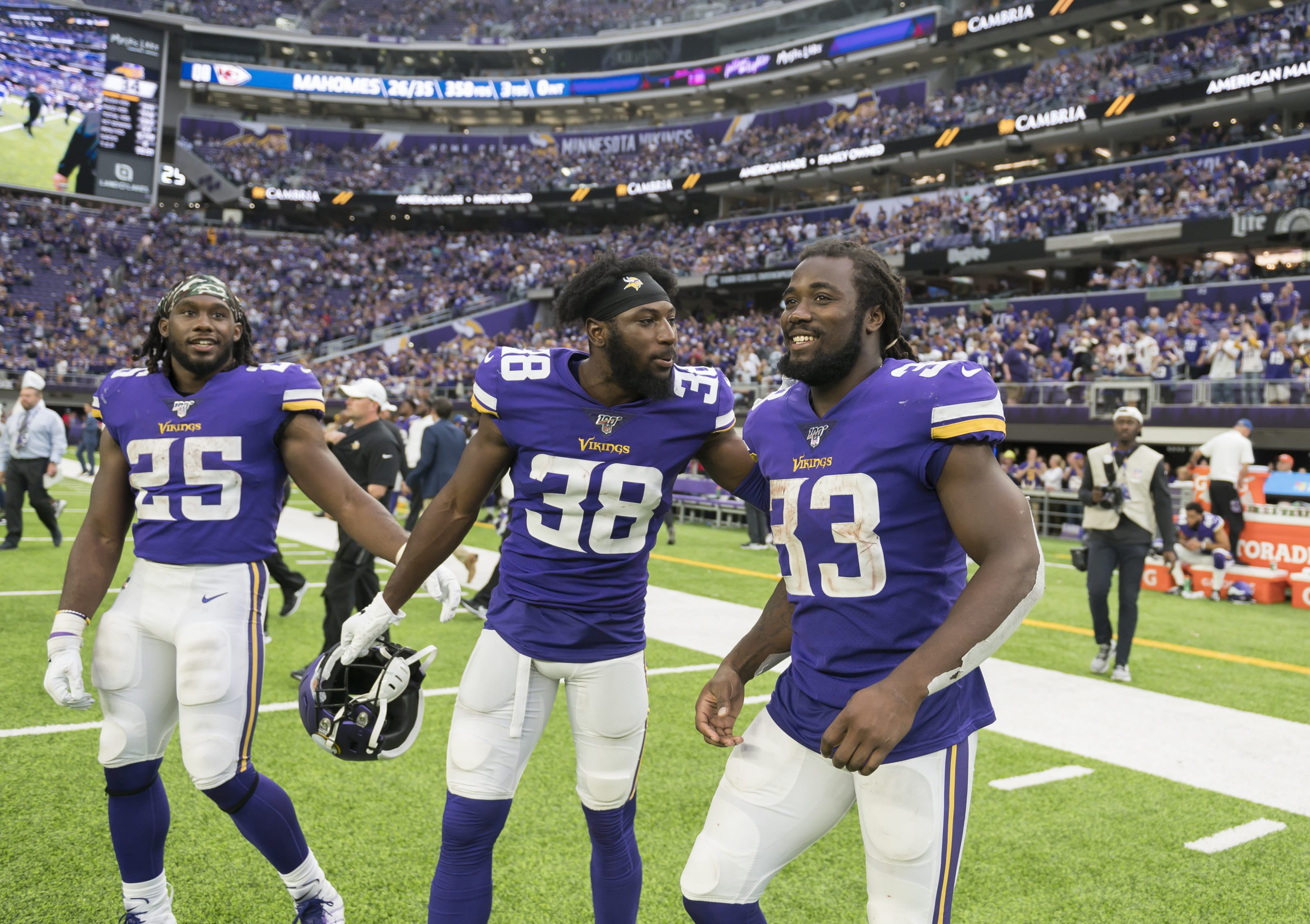 MINNEAPOLIS, MN - SEPTEMBER 22: Alexander Mattison #25, Kris Boyd #38, and Dalvin Cook #33 of the Minnesota Vikings take the field after the game against the Oakland Raiders at U.S. Bank Stadium on September 22, 2019 in Minneapolis, Minnesota. The Vikings defeated the Raiders 34-14. (Photo by Stephen Maturen/Getty Images)