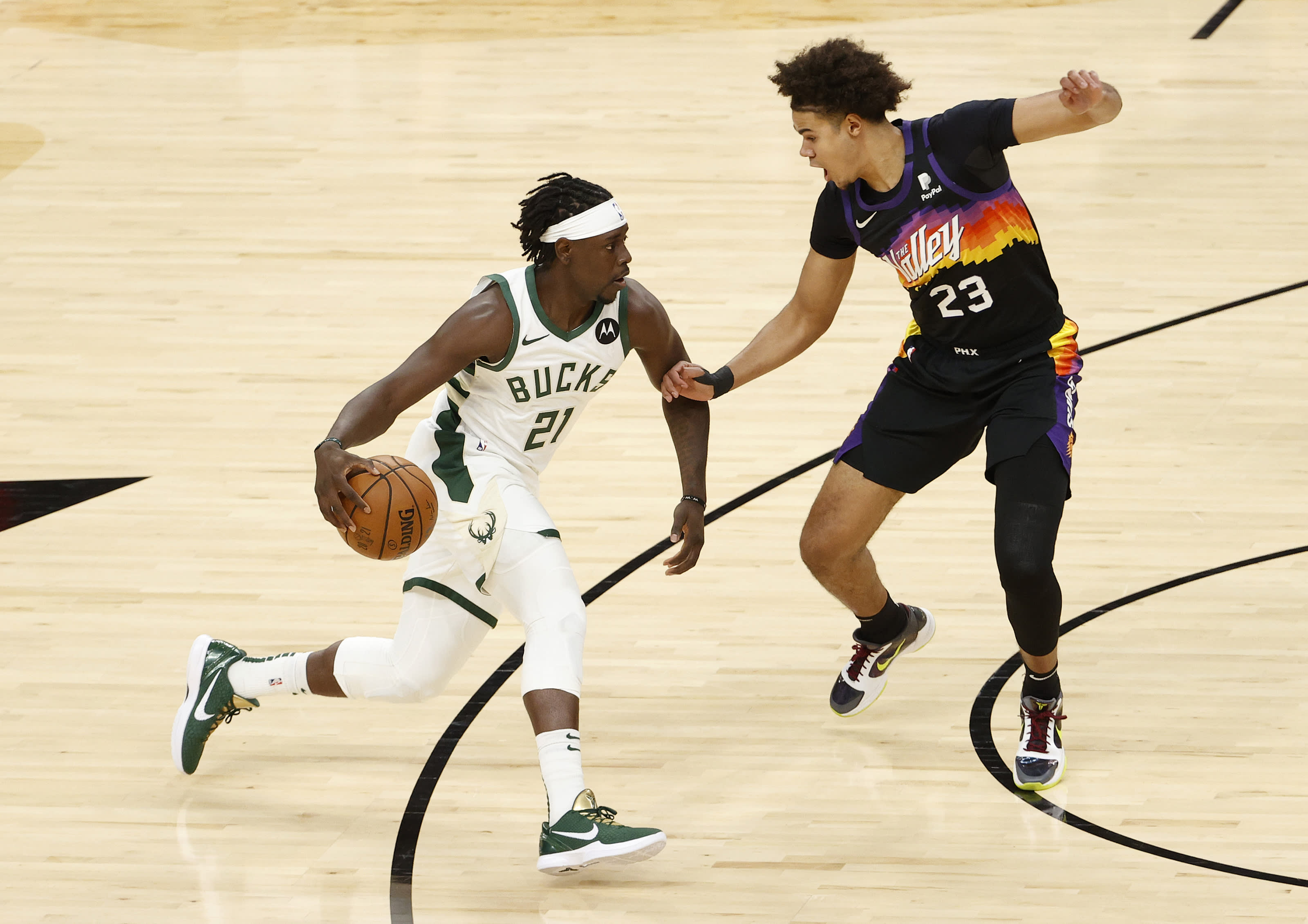 Milwaukee Bucks: Jrue Holiday, Phoenix Suns: Cameron Johnson