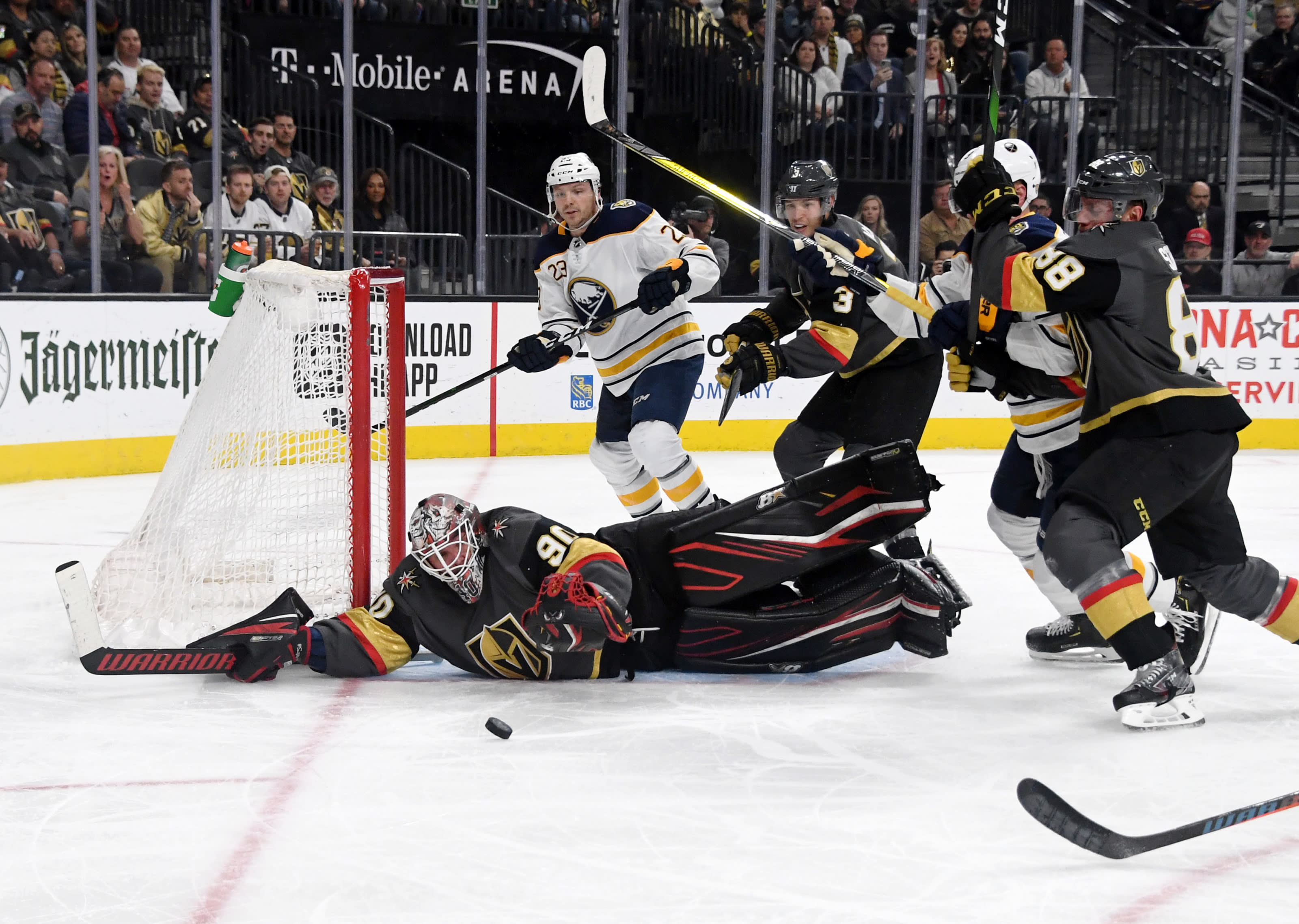 Robin Lehner #90 of the Vegas Golden Knights makes a diving save against the Buffalo Sabres.