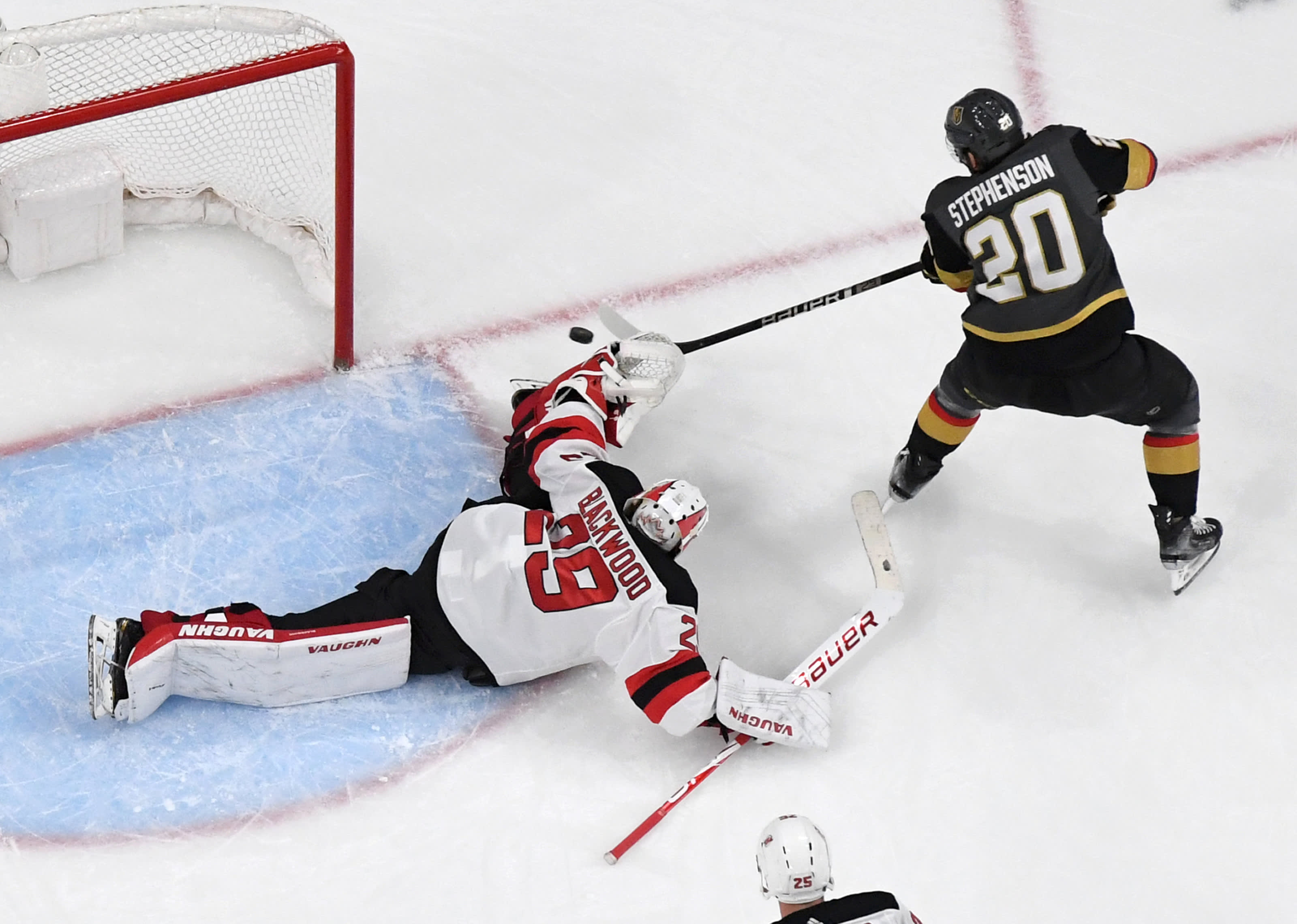 Chandler Stephenson #20 of the Vegas Golden Knights hits the goalpost with a shot after deking around Mackenzie Blackwood #29 of the New Jersey Devils.