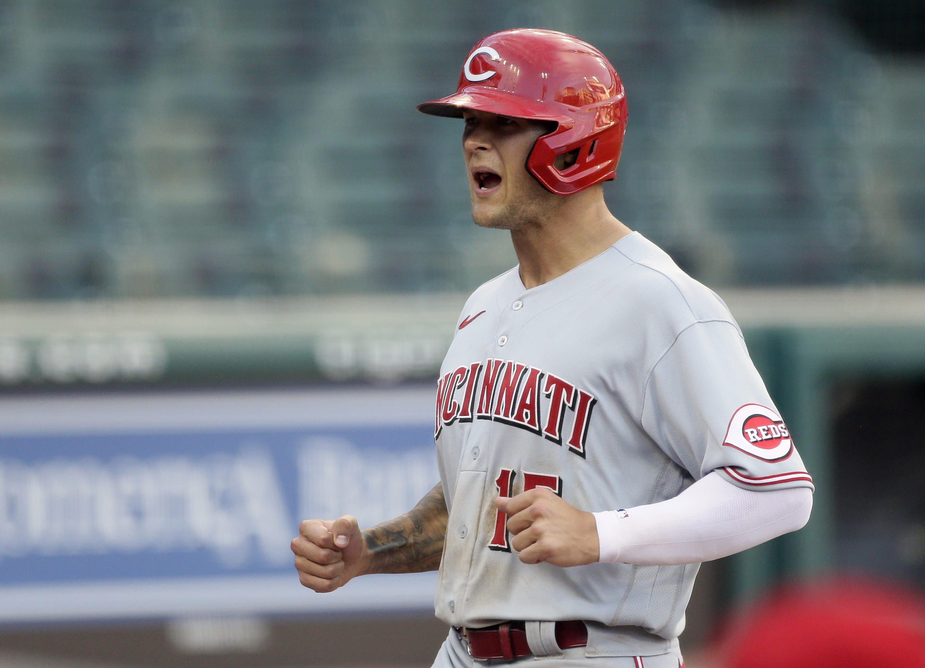 Nick Senzel #15 of the Cincinnati Reds celebrates as he scores on a single.