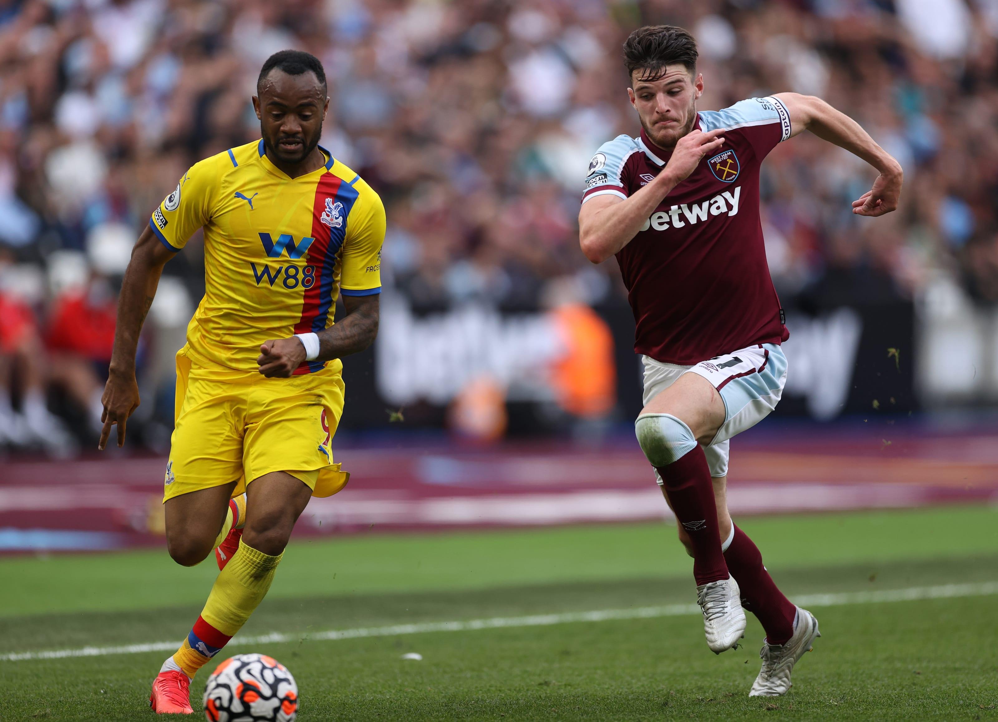 Jordan Ayew of Crystal Palace is chased by Declan Rice of West Ham. (Photo by Eddie Keogh/Getty Images)