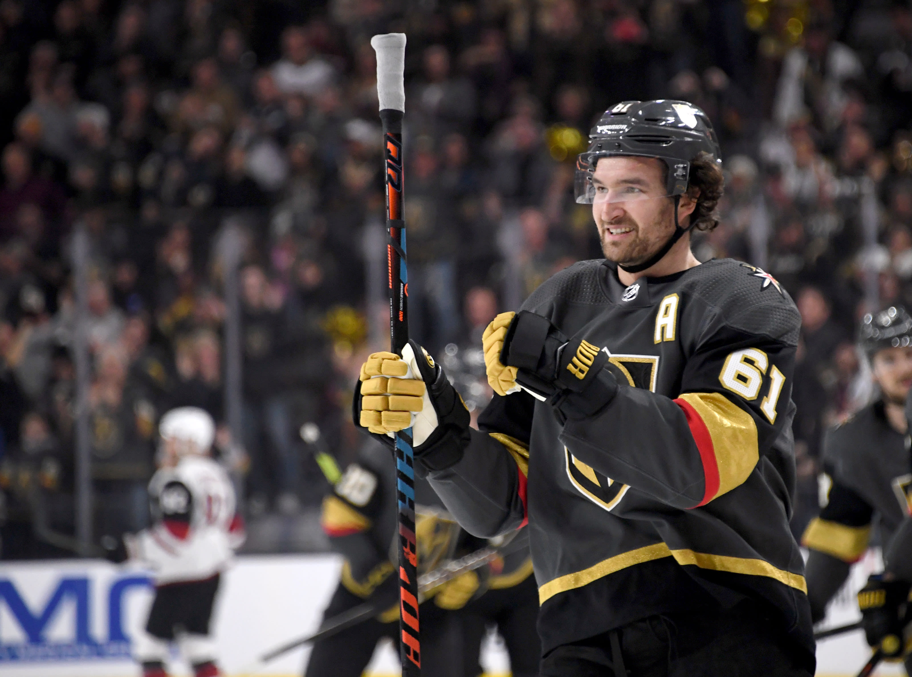 Mark Stone #61 of the Vegas Golden Knights celebrates after scoring his second first-period goal against the Arizona Coyotes.