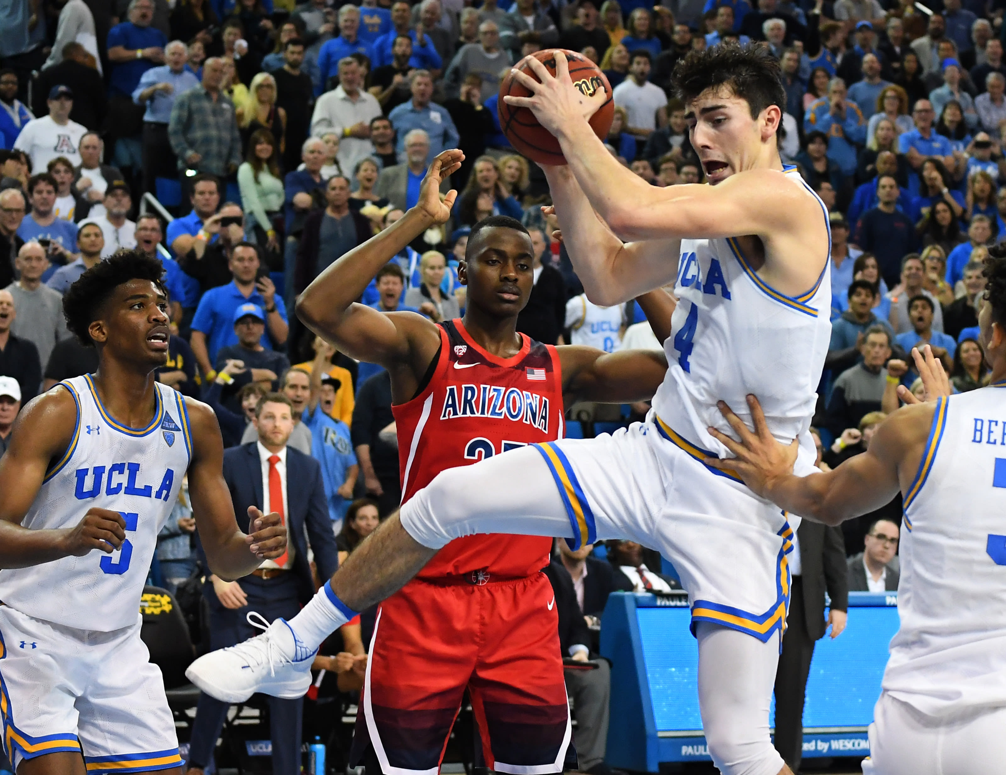 Jaime Jaquez Jr. #4 of the UCLA Bruins grabs a rebound in front of Christian Koloko #35 of the Arizona Wildcats in the second half of the game at Pauley Pavilion on February 29,