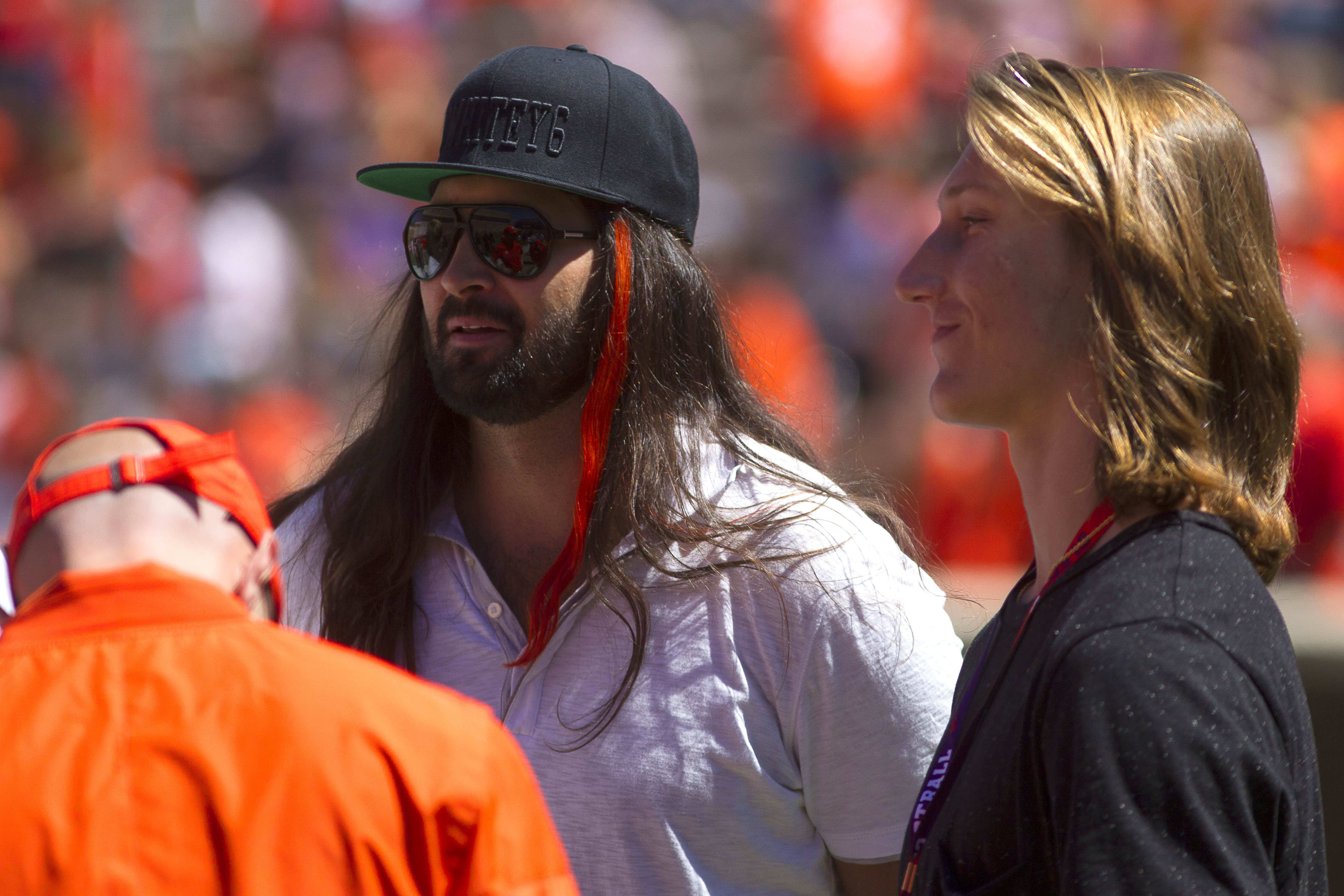Apr 8, 2017; Clemson, SC, USA; Former Clemson Tigers quarterback Charlie Whitehurst (left) talks with 2018 quarterback commit Trevor Lawrence (right) on the sidelines prior to the Clemson spring game at Memorial Stadium. Mandatory Credit: Joshua S. Kelly-USA TODAY Sports