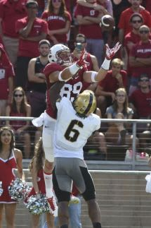Stanford Cardinal wide receiver Devon Cajuste (89) catches a touchdown pass against Army Black Knights defensive back Geoffery Bacon (6). Kyle Terada-USA TODAY Sports