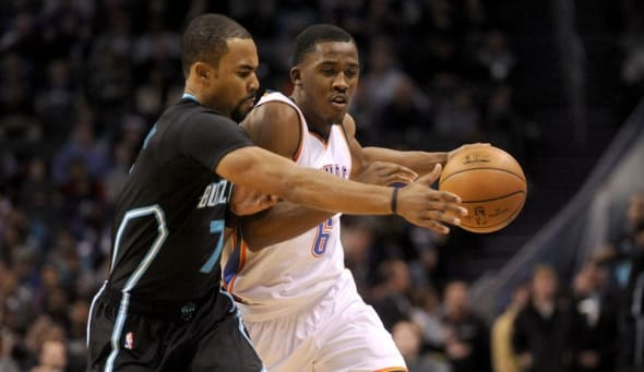 Jan 4, 2017; Charlotte, NC, USA; Charlotte Hornets guard Ramon Sessions (left) steals the ball from Oklahoma City Thunder guard Semaj Christon (6) during the first half at the Spectrum Center. Mandatory Credit: Sam Sharpe-USA TODAY Sports