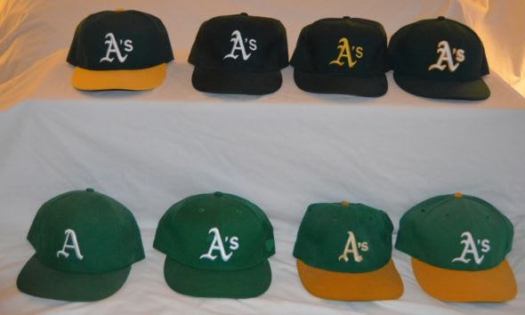 The A's have had 10 styles of caps since 1968 (Black style excluded in photo) Photo by Richard Paloma