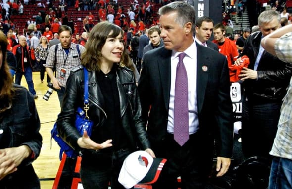 May 10, 2014; Portland, OR, USA; Portland Trail Blazers general manager Neil Olshey (R) talks to actress Carrie Brownstein of Portlandia (L) after game three of the second round of the 2014 NBA Playoffs between the Portland Trail Blazers and San Antonio Spurs at the Moda Center. Mandatory Credit: Craig Mitchelldyer-USA TODAY Sports