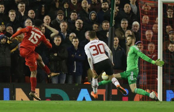 LIVERPOOL, ENGLAND - MARCH 10: David de Gea of Manchester United makes a save from Daniel Sturridge of Liverpool during the UEFA Europa League round of 16 first leg match between Liverpool and Manchester United at Anfield on March 10, 2016 in Liverpool, United Kingdom. (Photo by John Peters/Man Utd via Getty Images)