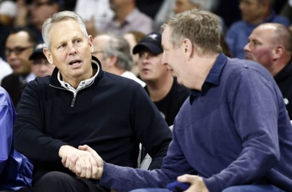 Jan 5, 2016; Providence, RI, USA; Boston Celtics president of basketball operations Danny Ainge (left) speaks to fans during the first half of a game between the Providence Friars and the Marquette Golden Eagles at Dunkin Donuts Center. Mandatory Credit: Mark L. Baer-USA TODAY Sports