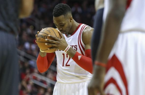 Dec 29, 2015; Houston, TX, USA; Houston Rockets center Dwight Howard (12) attempts a free throw during the fourth quarter against the Atlanta Hawks at Toyota Center. The Hawks defeated the Rockets 121-115. Mandatory Credit: Troy Taormina-USA TODAY Sports