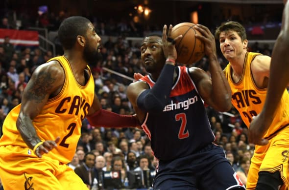 Feb 6, 2017; Washington, DC, USA; Washington Wizards guard John Wall (2) makes a move to the basket asCleveland Cavaliers guard Kyrie Irving (2) defends during the third quarter at Verizon Center. Cleveland Cavaliers defeated Washington Wizards 140-135 in third quarter. Mandatory Credit: Tommy Gilligan-USA TODAY Sports